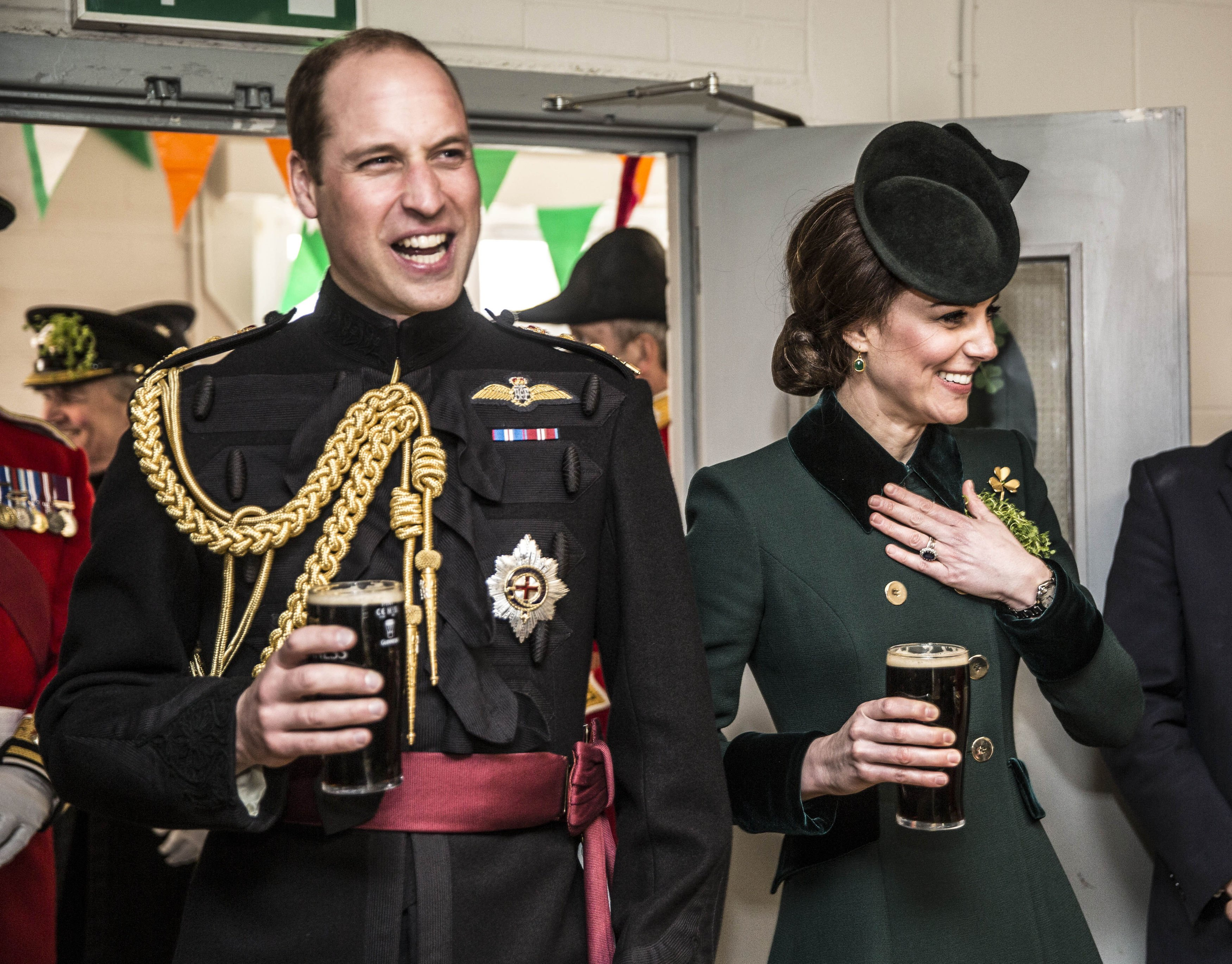 The Duke and Duchess of Cambridge stand with pints of Guinness in their hands as they meet with soldiers of the 1st Battalion Irish Guards in their canteen following their St. Patrick's Day parade at Cavalry Barracks, Hounslow on March 17, 2017.