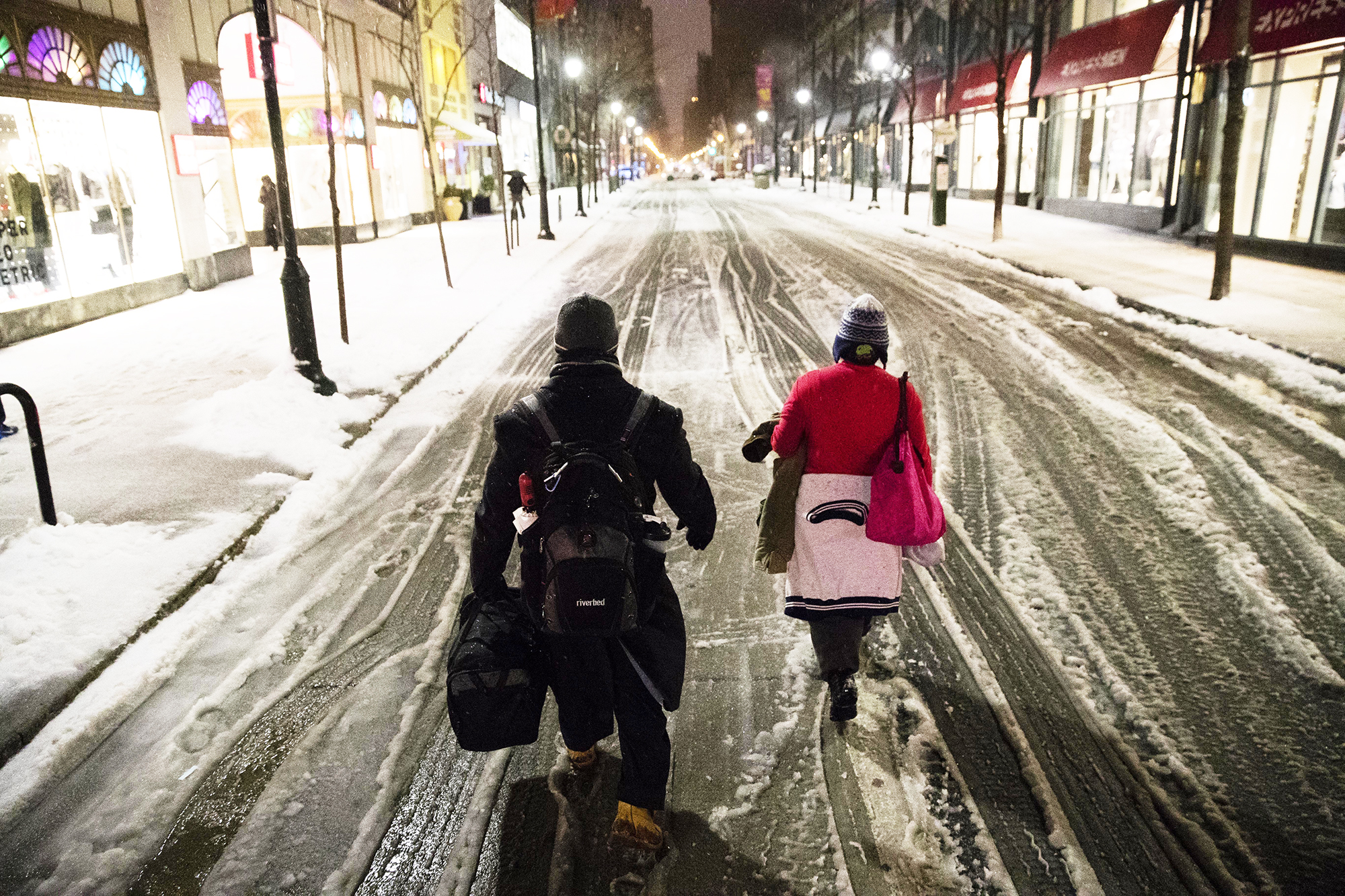 A couple walks in the street during Winter Storm Stella in Philadelphia, on March 14, 2017.