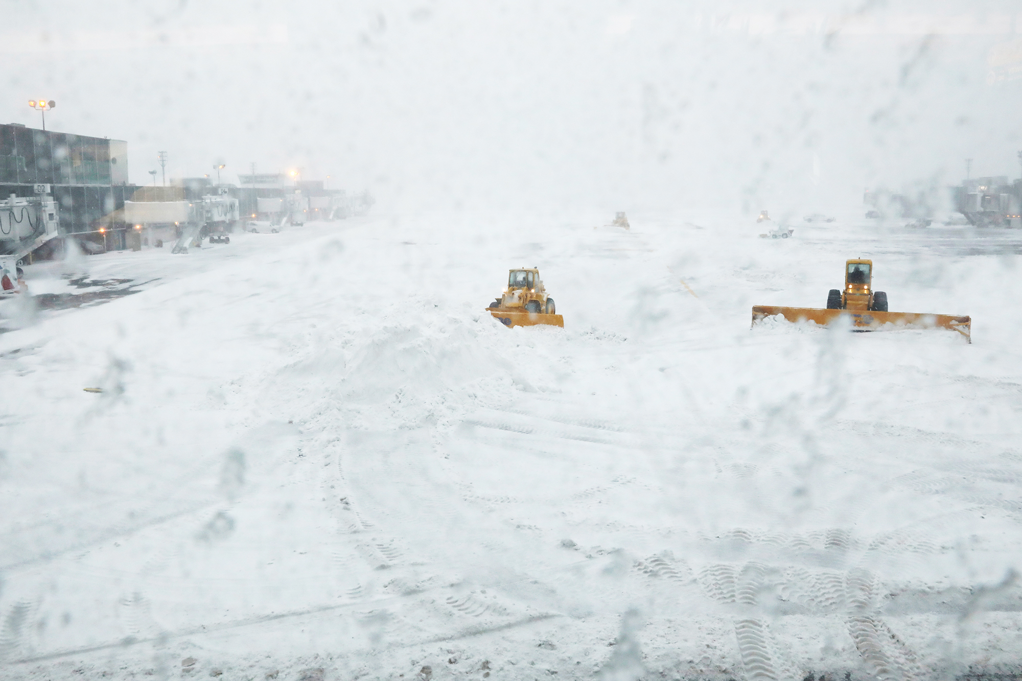 Snowplows clear the runway of snow at LaGuardia Airport in New York City, on March 14, 2017.