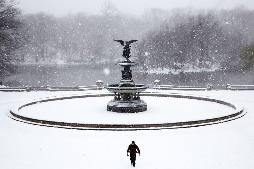 A man walks in Central Park as snow falls in Manhattan, New York