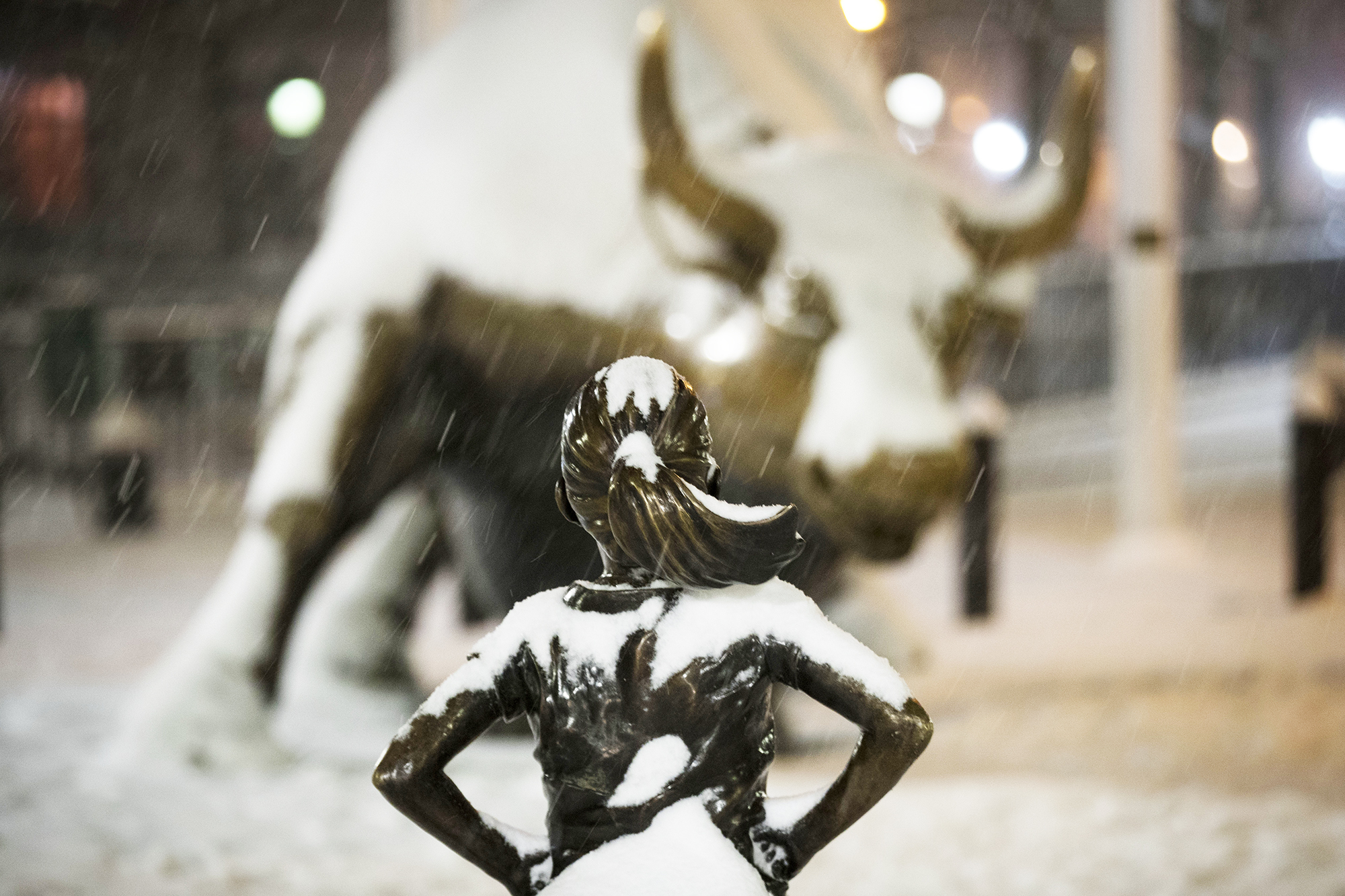 The 'Fearless Girl' statue stands in the snow in New York City's Financial District,  on March 14, 2017.
