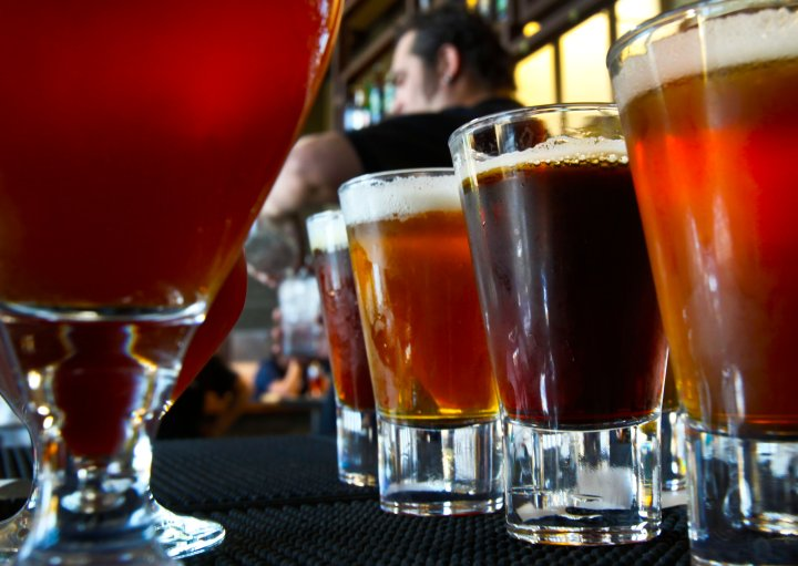 A variety of beers are lined–up on the bar at the Stone Brewing World Bistro and Gardens January 17