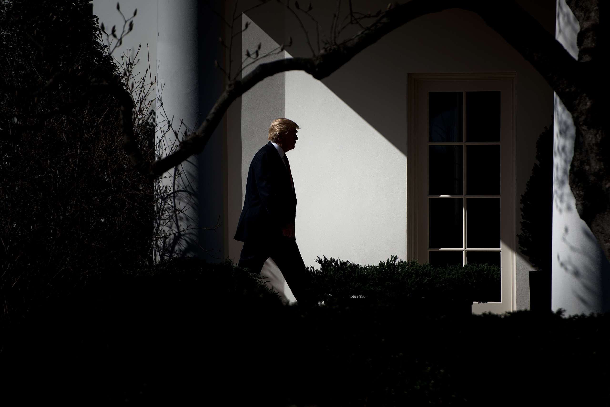 US President Donald Trump walks from Marine One to the White House February 24, 2017 in Washington, DC.