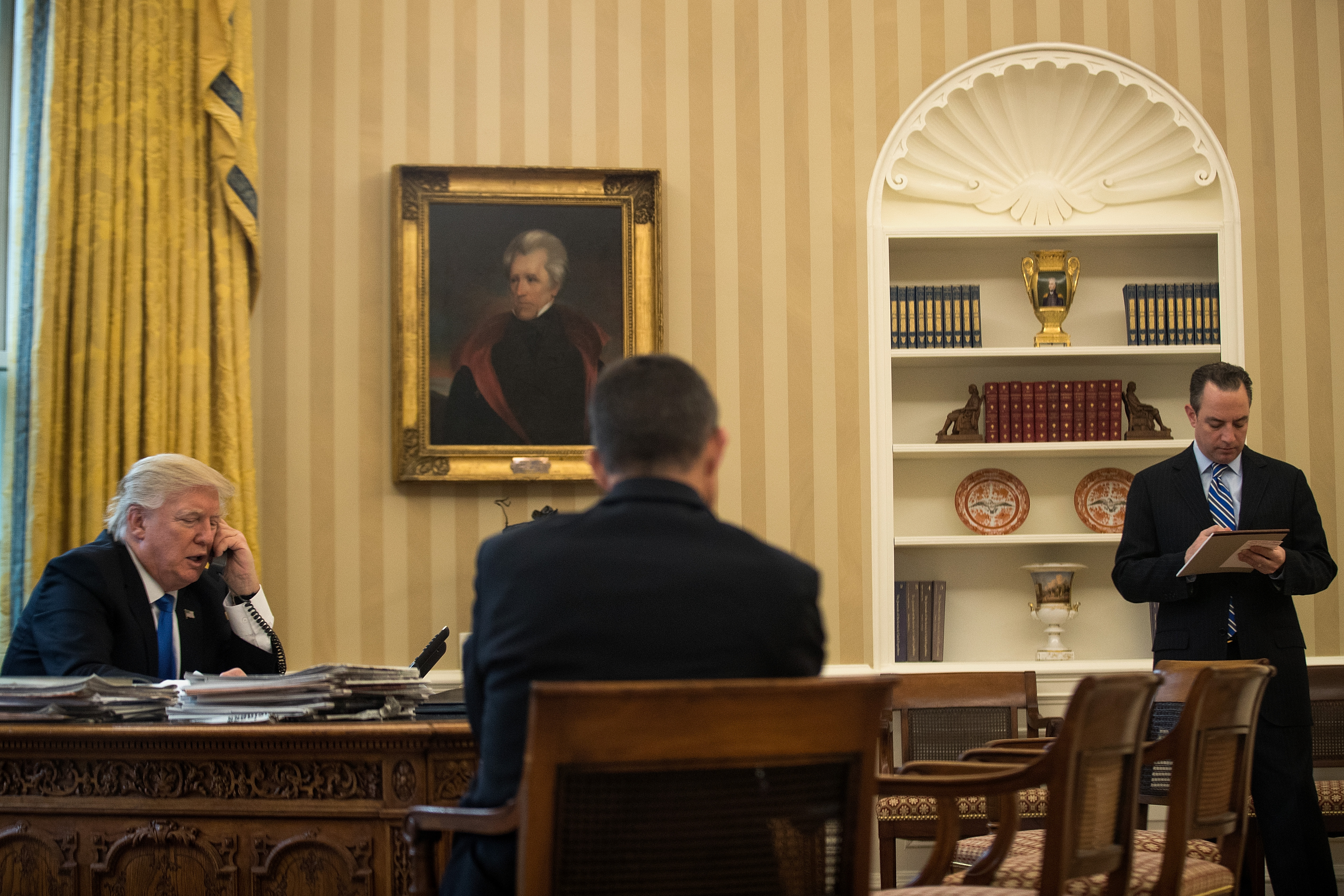 President Donald Trump speaks by phone with Chancellor of Germany Angela Merkel in the Oval Office of the White House, January 28, 2017 in Washington, DC. Merkel's meeting at the White House has been postponed to Friday March 17 because of weather.