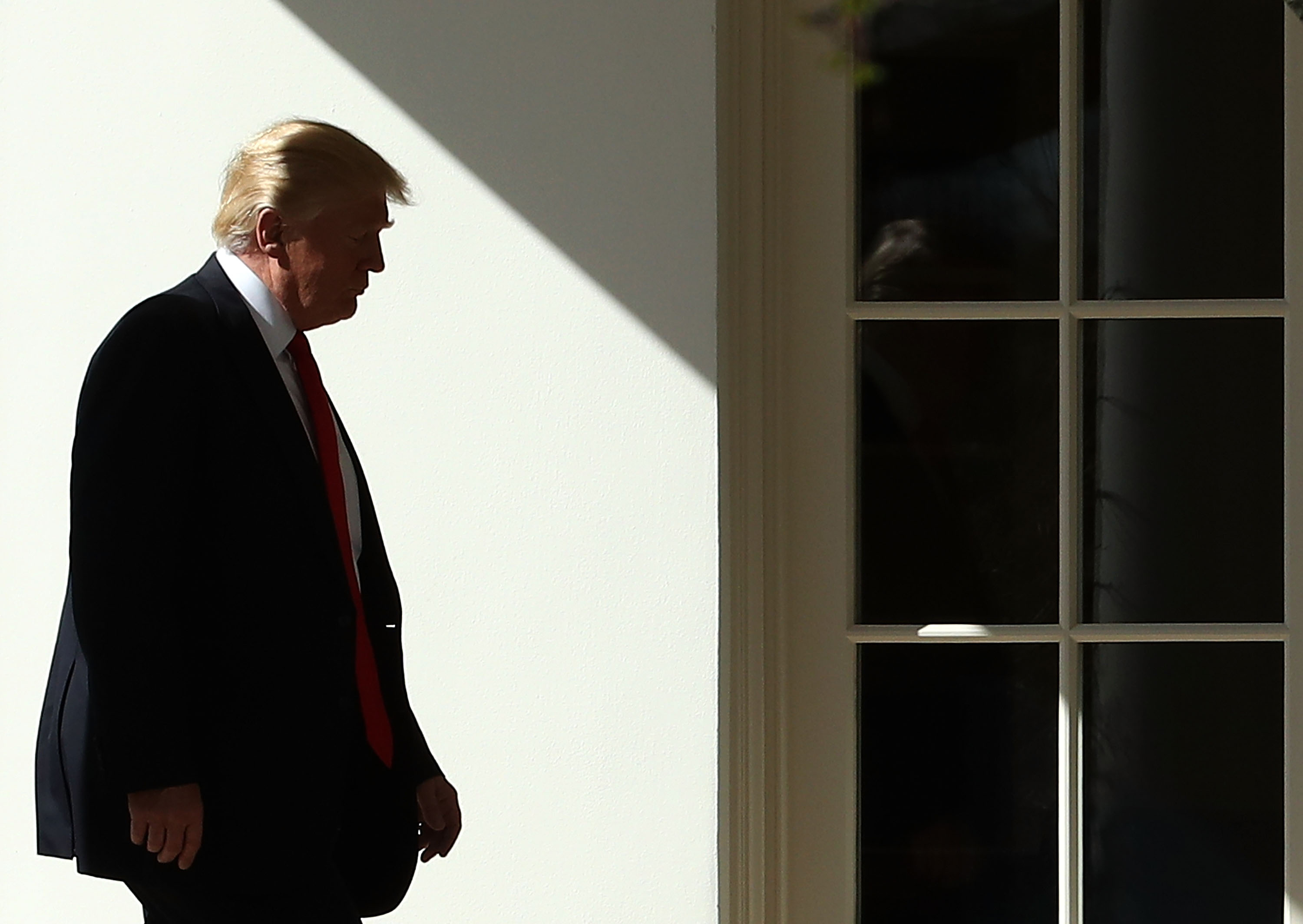 President Trump walks to the Oval Office at the White House, on Feb. 24, 2017.