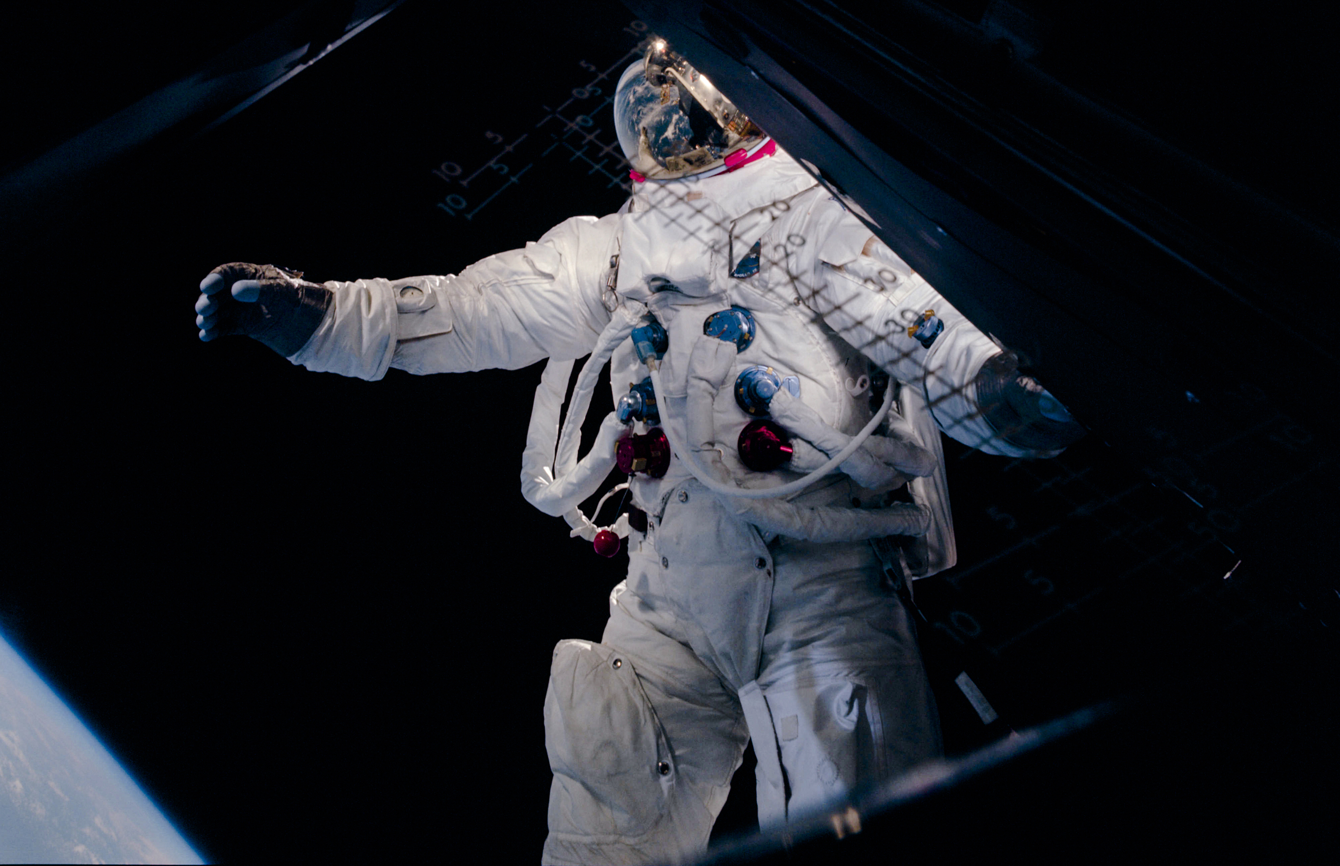Rusty Schweickart, during a spacewalk in Earth orbit. Here, Schweickart may be trying to regain his balance by pinwheeling his arm forward. The result, however, gave him the look more of a man in full stride.