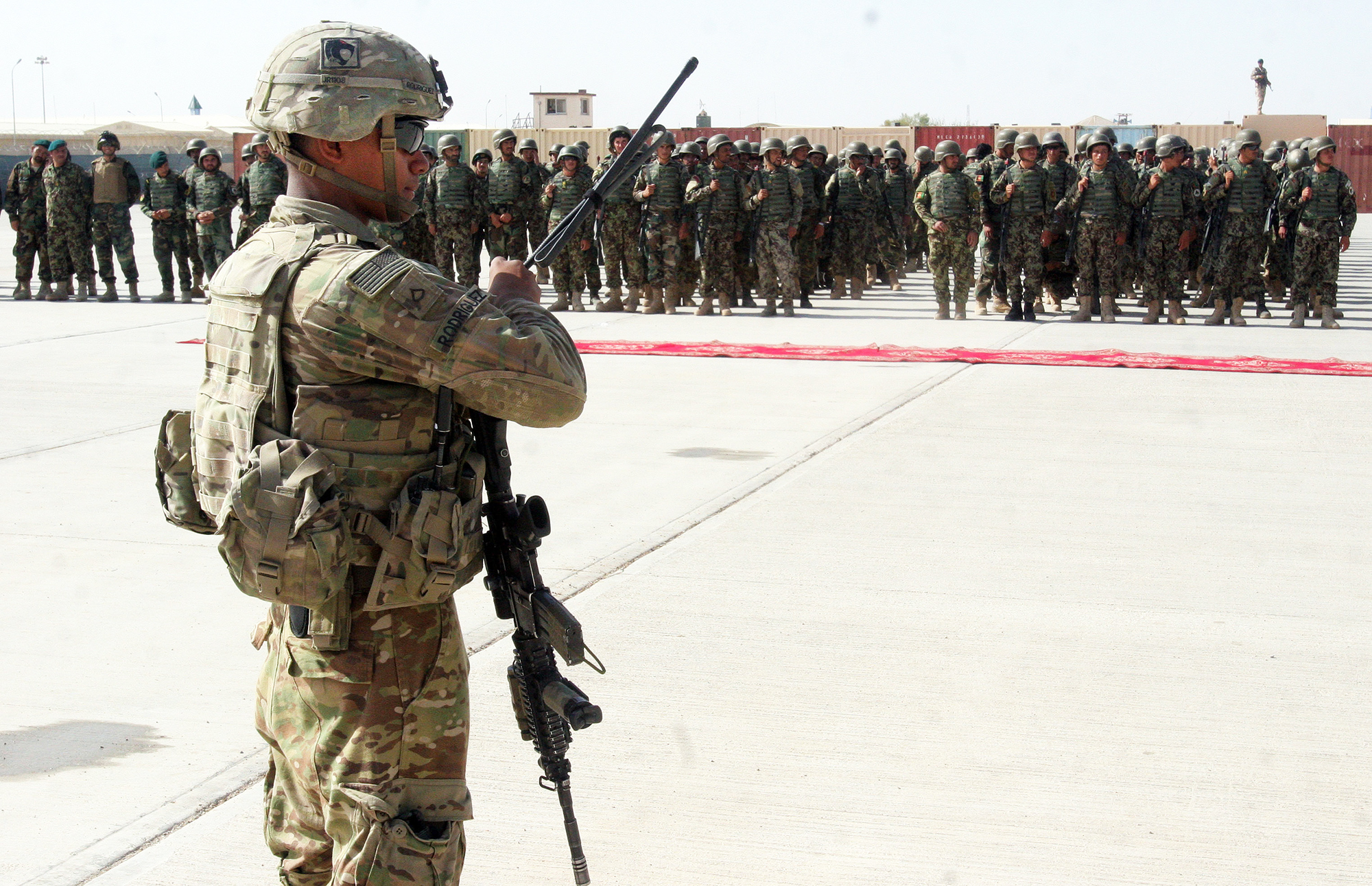 U.S. military personal stand guard during a graduation ceremony in Lashkargah, Afghanistan, on July 24, 2016.