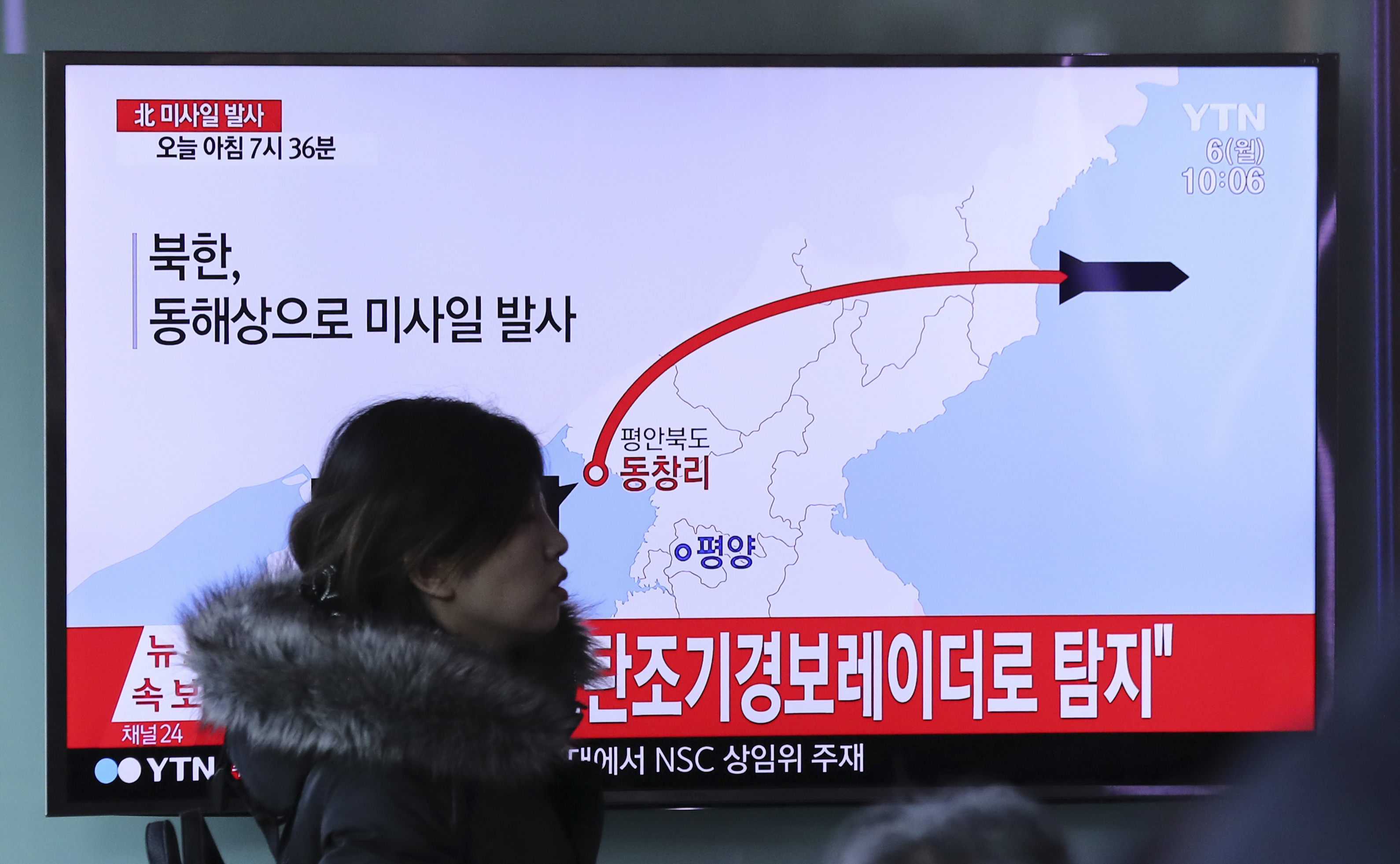 In this March 6, 2017 file photo, a TV screen shows a report about North Korea's missile firing, at Seoul Train Station in South Korea.
