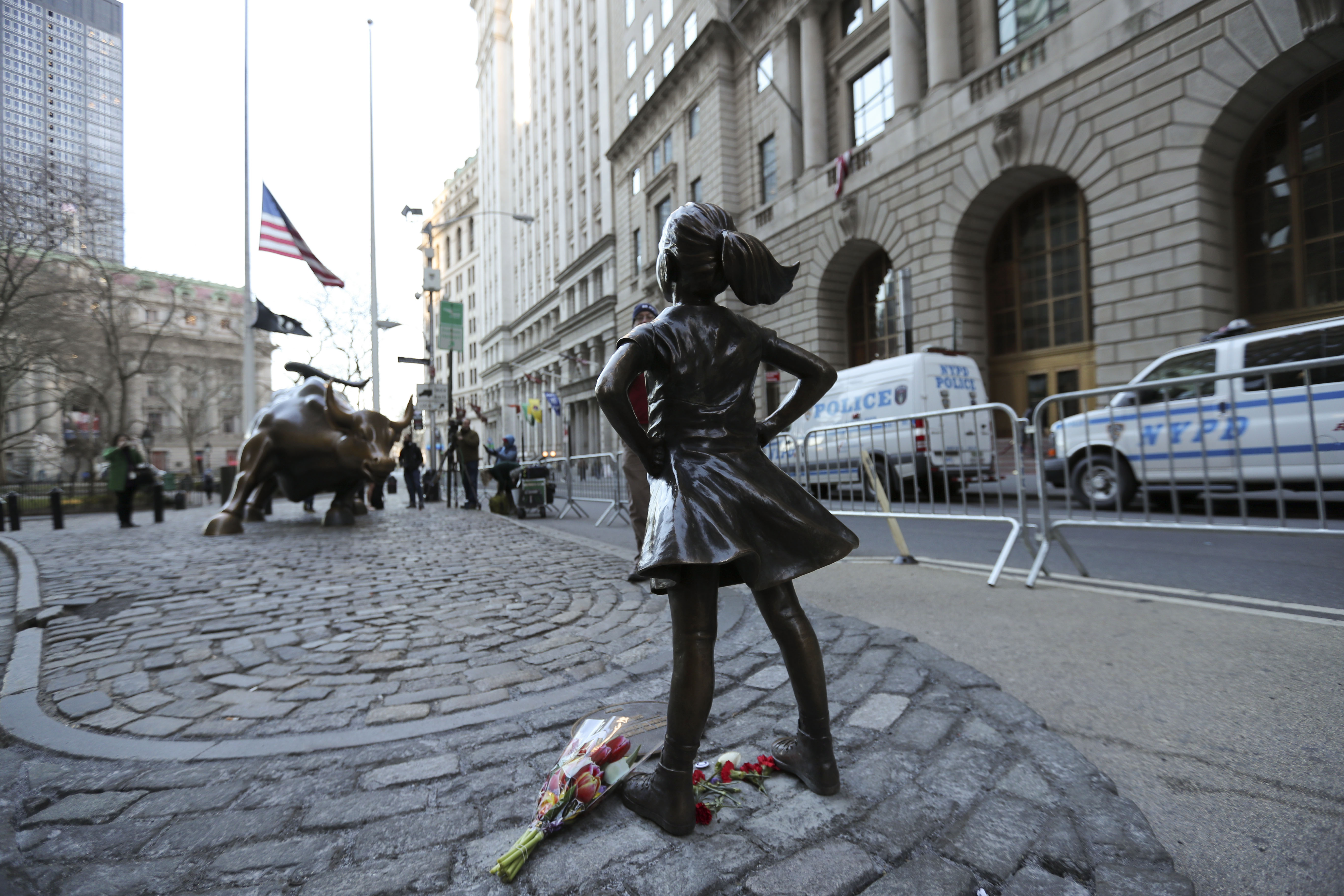 NEW YORK, March 9, 2017 :   Photo taken on March 9, 2017 shows the  fearless girl  statue facing the bronze bull statue near the Wall Street in New York, the United States. The  fearless girl  was put there by an investment firm which said the idea was to call attention to the lack of gender diversity in management of companies as well as how few women work in financial services, and the fact that they get paid less than men. (Xinhua/Wang Ying via Getty Images)