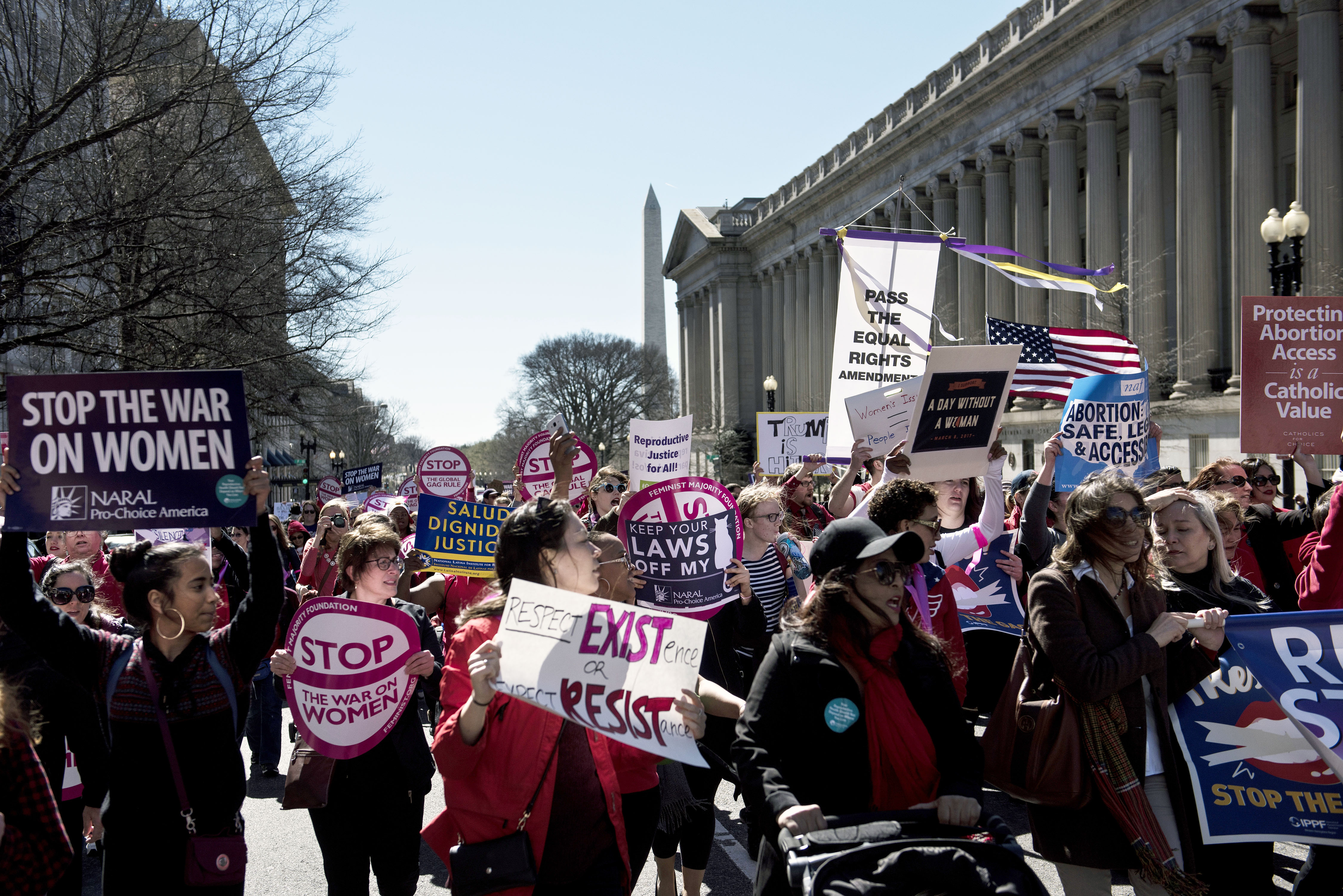 Activists protest the Trump administration and rally for women's rights during a march to honor International Woman's Day on March 8, 2017 in Washington, DC.