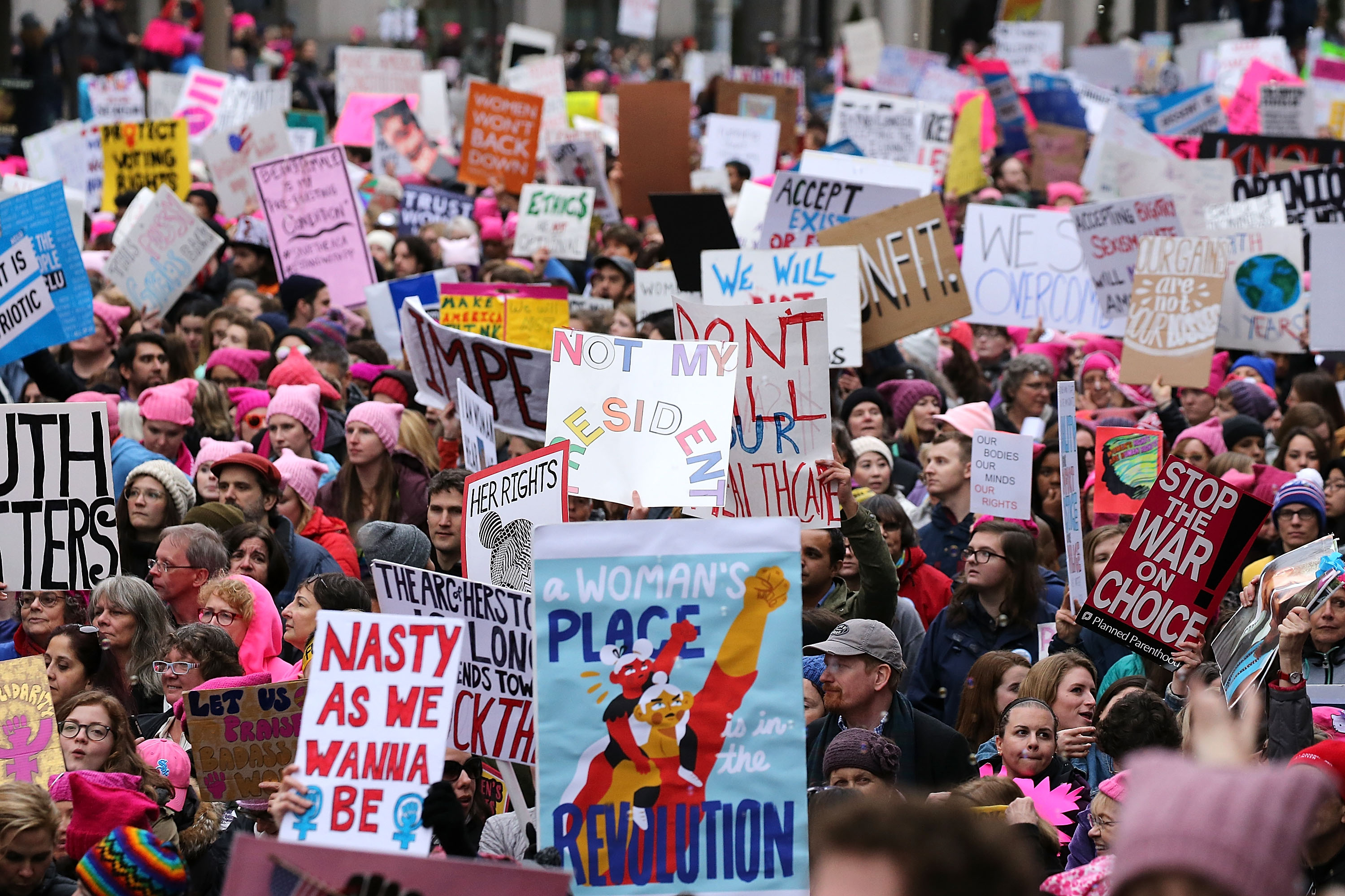 WASHINGTON, DC - JANUARY 21:  Protesters march on Pennsylvania Avenue during the Women's March on Washington on January 21, 2017 in Washington, DC.  (Photo by Paul Morigi/WireImage)