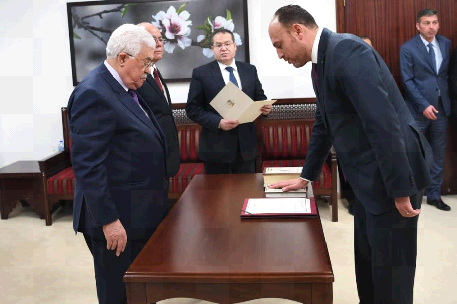 Husam Zomlot is sworn-in in front of President Mahmoud Abbas as head of the PLO General Delegation to the United States on March 7 (Usama Falah-WAFA)