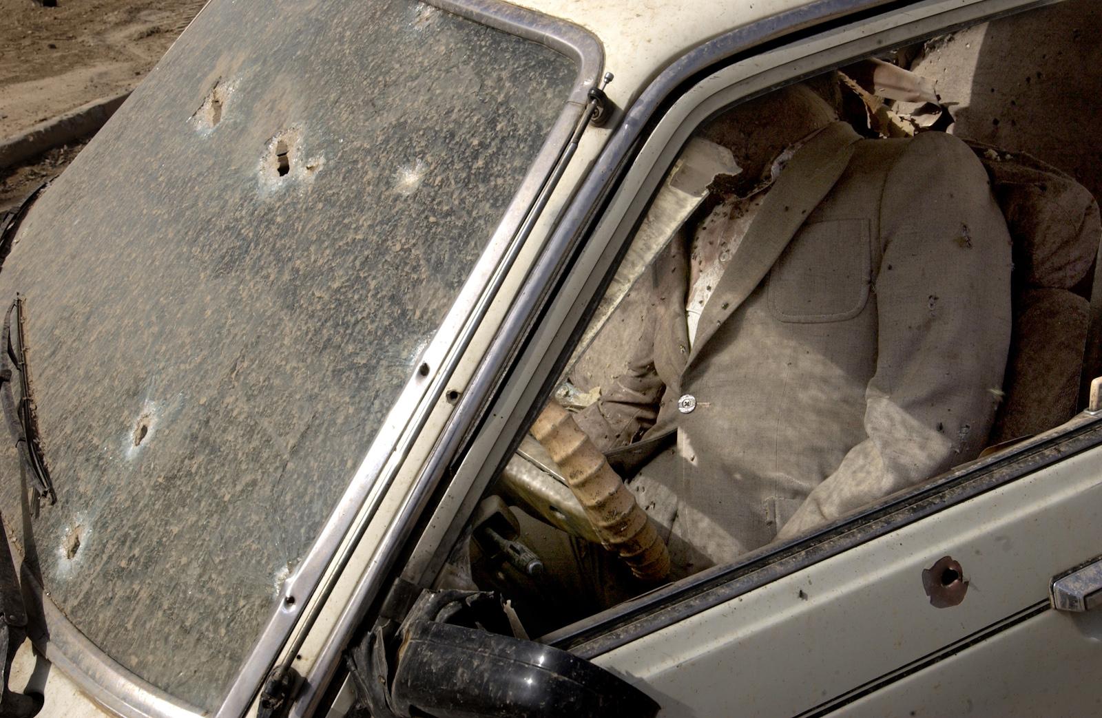 A body of a man killed by a US Army sniper, Baghdad, Iraq. April 10, 2003.