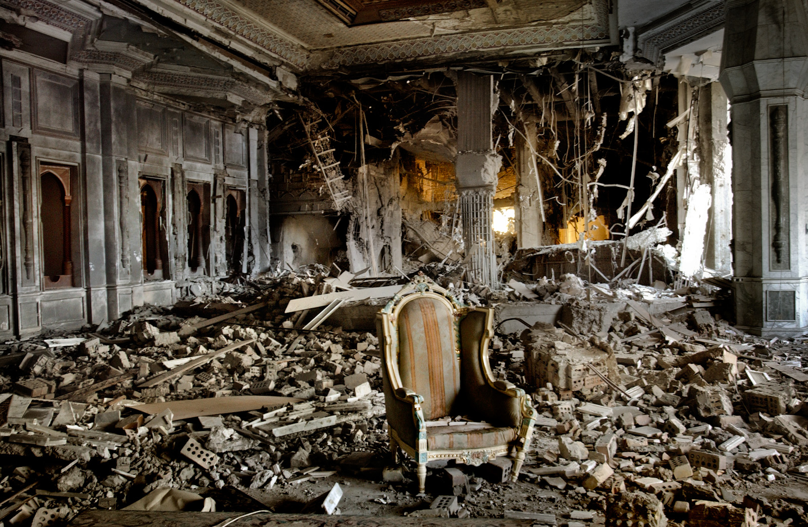 A gilded chair sits in the middle of Saddam Hussein's Palace, destroyed earlier by intensive U.S. aerial bombardment, Baghdad, Iraq, April 12, 2003.