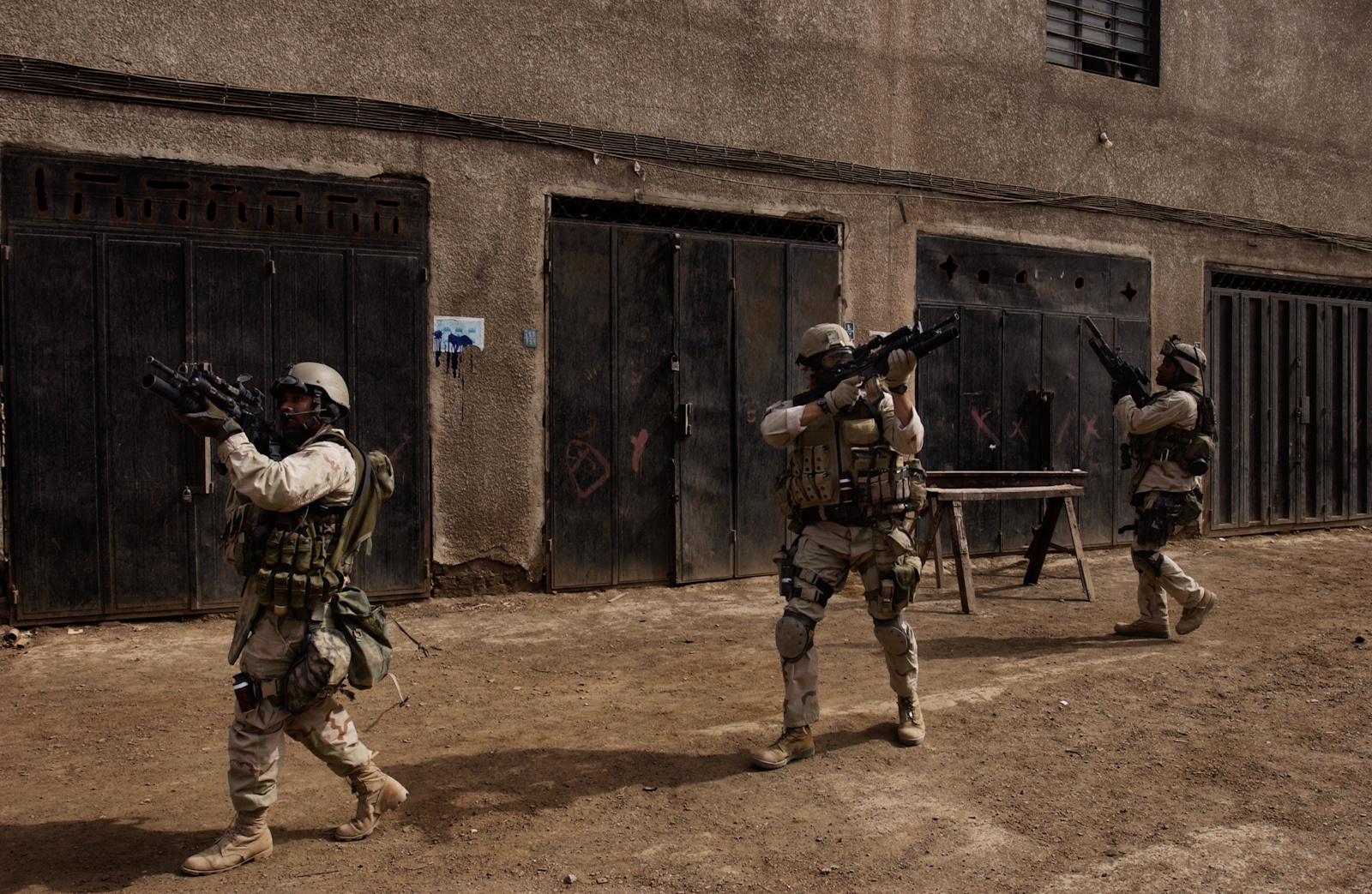 Soldiers search for militants who were targeting U.S. forces in Baghdad, Iraq, April 12, 2003.