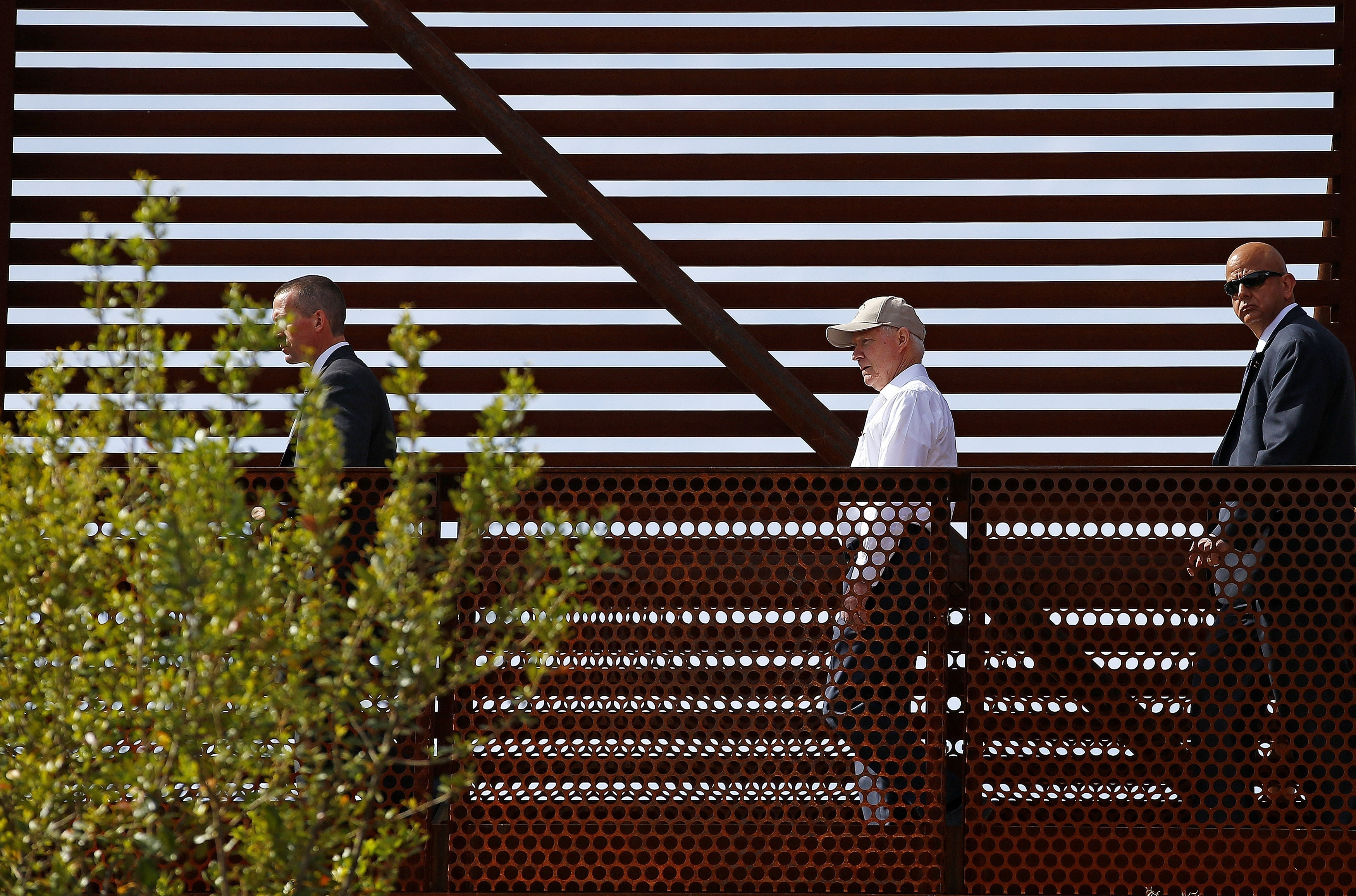 """Attorney General Jeff Sessions tours the U.S.-Mexico border with border officials in Nogales, Ariz. on April 11, 2017. A courthouse on the border in Texas is serving as a model for the kind of tough immigration enforcement advocated by President Donald Trump. """"This is a new era. This is the Trump era,"""" Sessions said during a visit to the border in Nogales, Ariz., this month."""