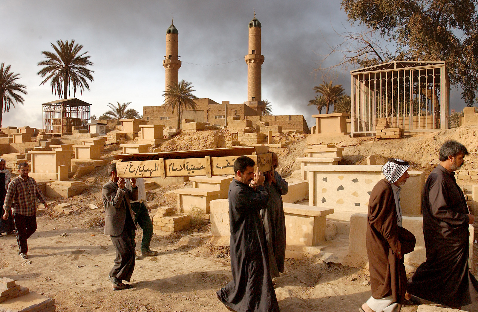 Mourners at a cemetery, Baghdad, Iraq, April 2, 2003.