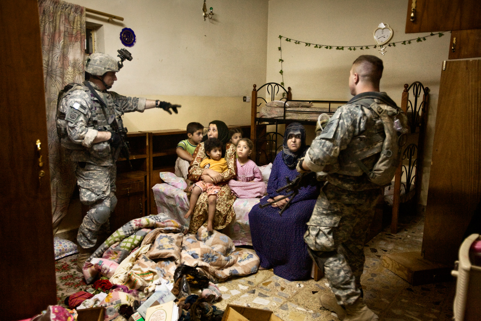 U.S. soldiers raid a home where they arrested two al Qaeda supporters in Samarra, Iraq, Sept, 28, 2007. This is the last mission for the 'Smash Platoon' before returning to the U.S.