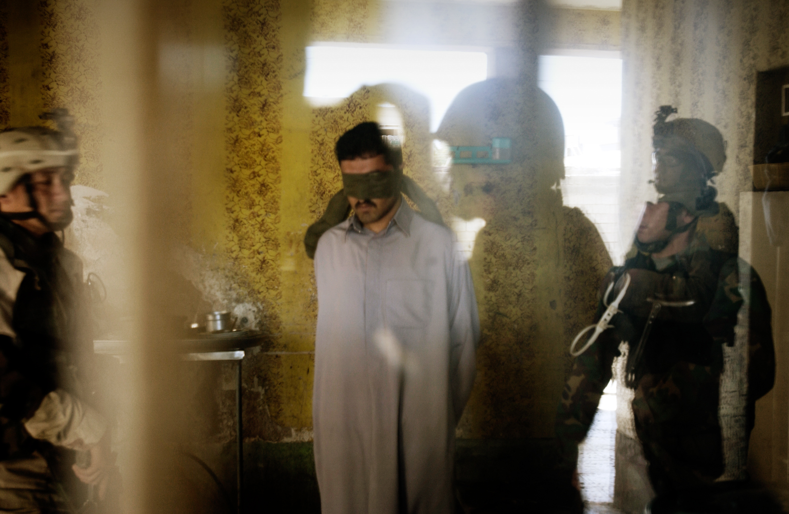 Soldiers of the 1st Battalion search house to house for insurgents in the Mula'ab disctrict in Ramadi, an insurgent stronghold west of Baghdad, Iraq, March 05, 2005.