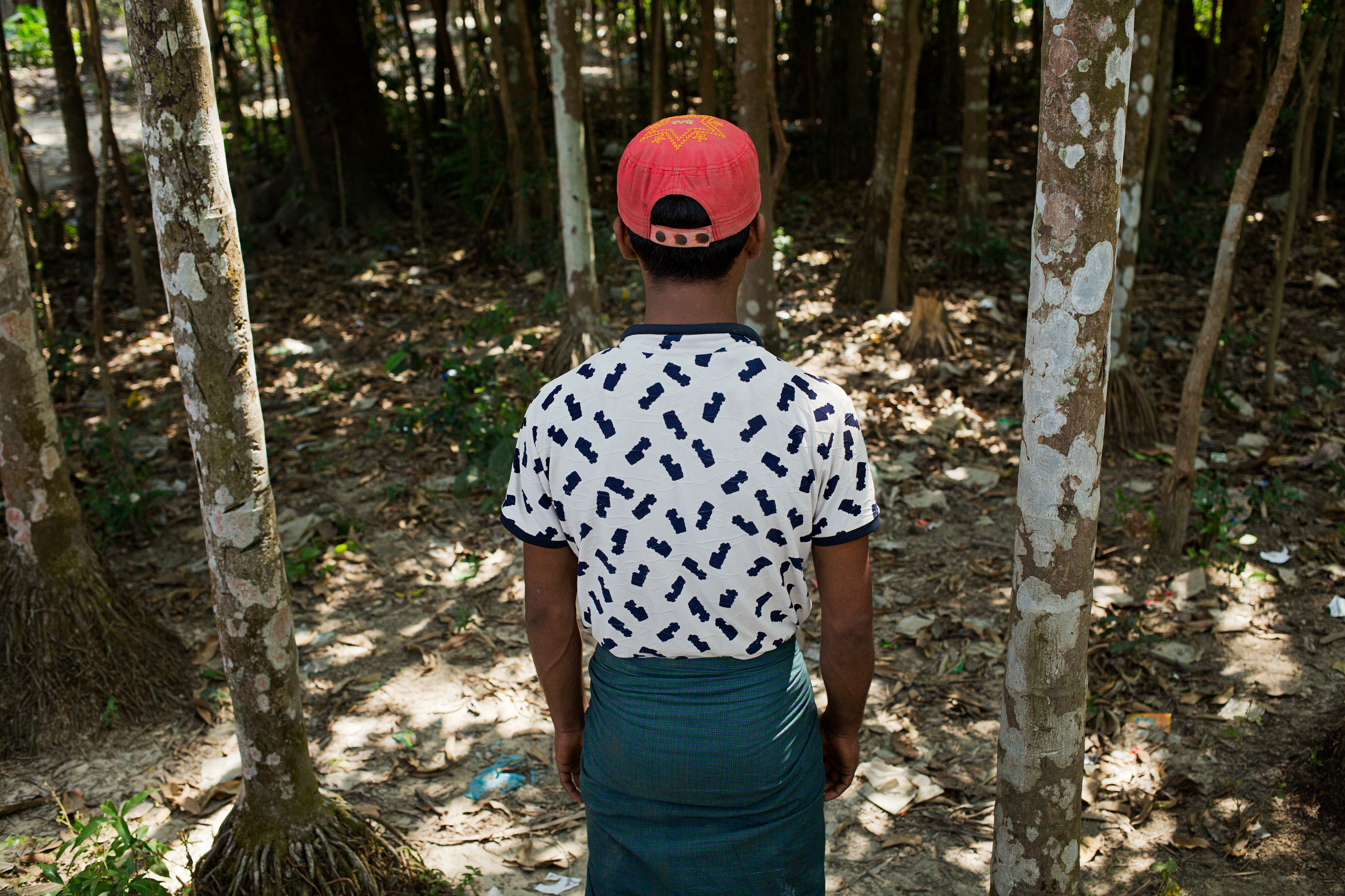 Ahmed Mahmood looks at the spot in Myo Thu Gyi village, in Myanmar's Rakhine state, where he saw the Myanmar Border Guard Police executing three villagers, on March 19, 2017