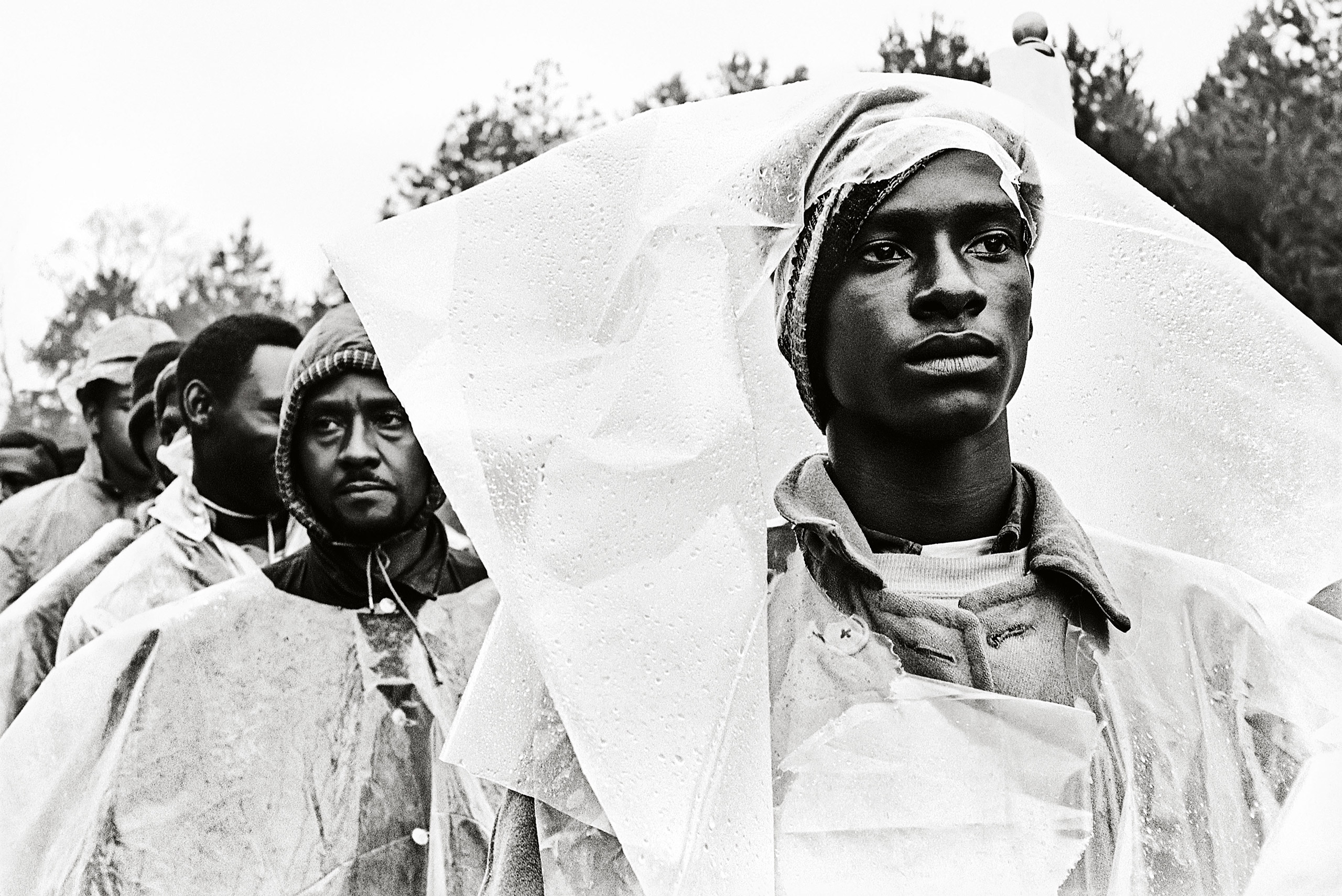"""Previously Published.                               Schapiro and other photographers followed the march for its five-day, fifty-four-mile route. """"We walked, and sometimes we would sit in the back of a wagon,"""" Schapiro recalls. """"At one point, it                               rained, and suddenly the whole march was wrapped in white plastic."""" Selma-to-Montgomery March, 1965."""