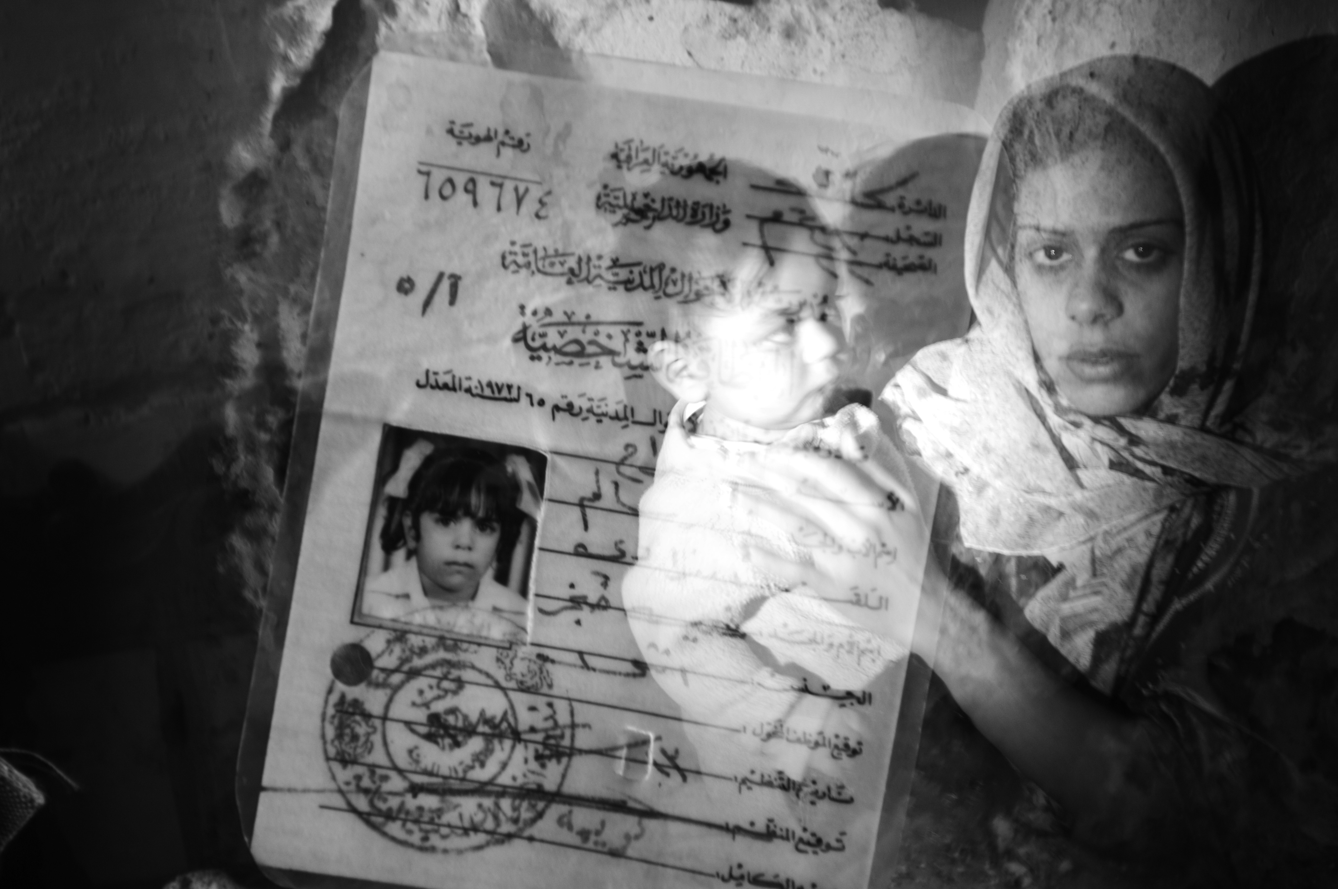 A double exposure photo of a Sunni woman  and her identity card in the Sunni Adhamiyah neighborhood of Baghdad, Iraq, Jan. 21,  2007. During the height of the civil war, as the city divided along sectarian lines, a Sunni or Shia name appearing on an identify card could result in death sentence.