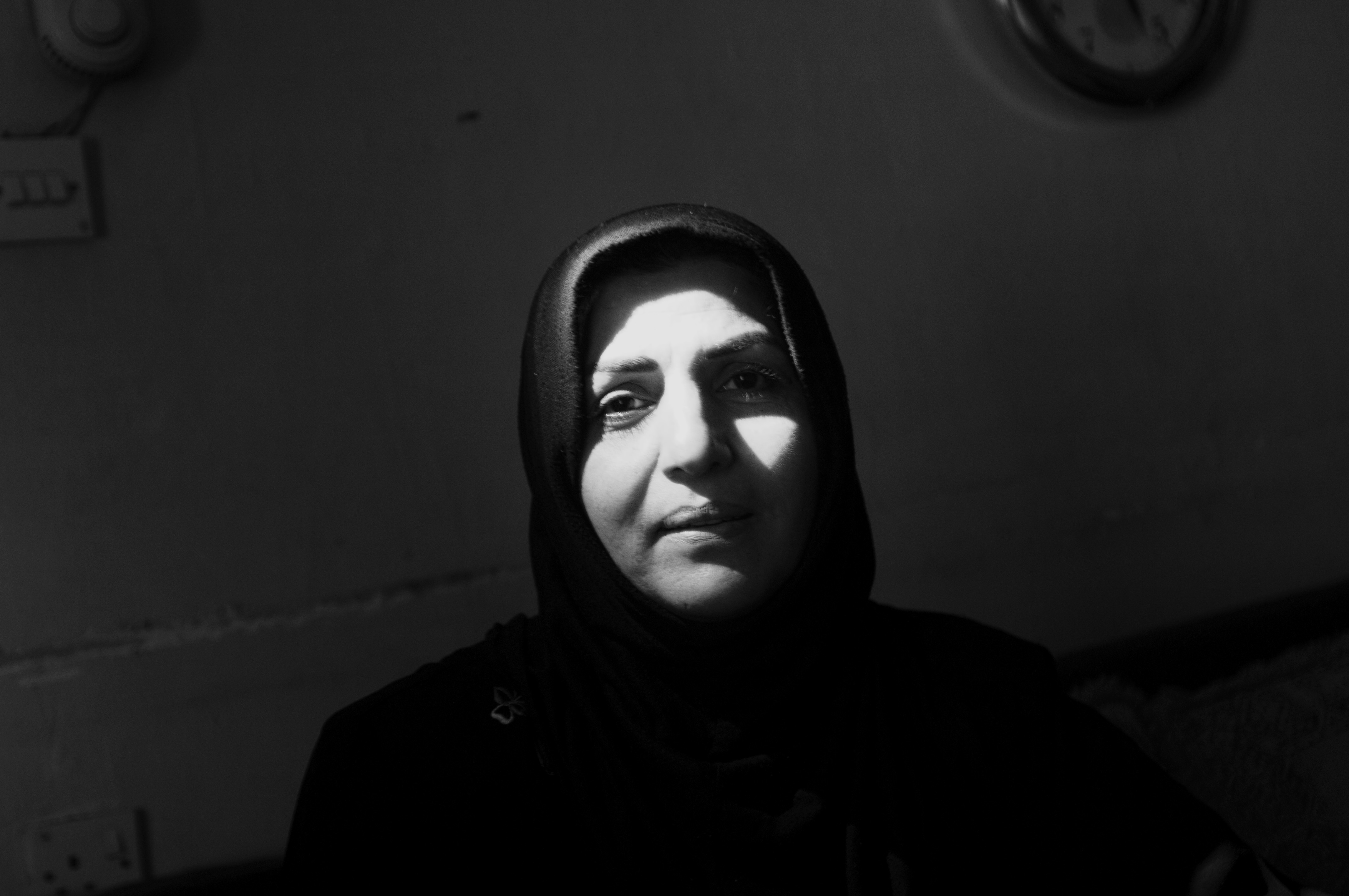 A Shi'ite woman in her home, Baghdad Feb.15, 2007. Where Iraqis of different faiths once mixed and lived next to each other, as the country erupted into civil war, people of different faiths rarely associated with former neighbors.
