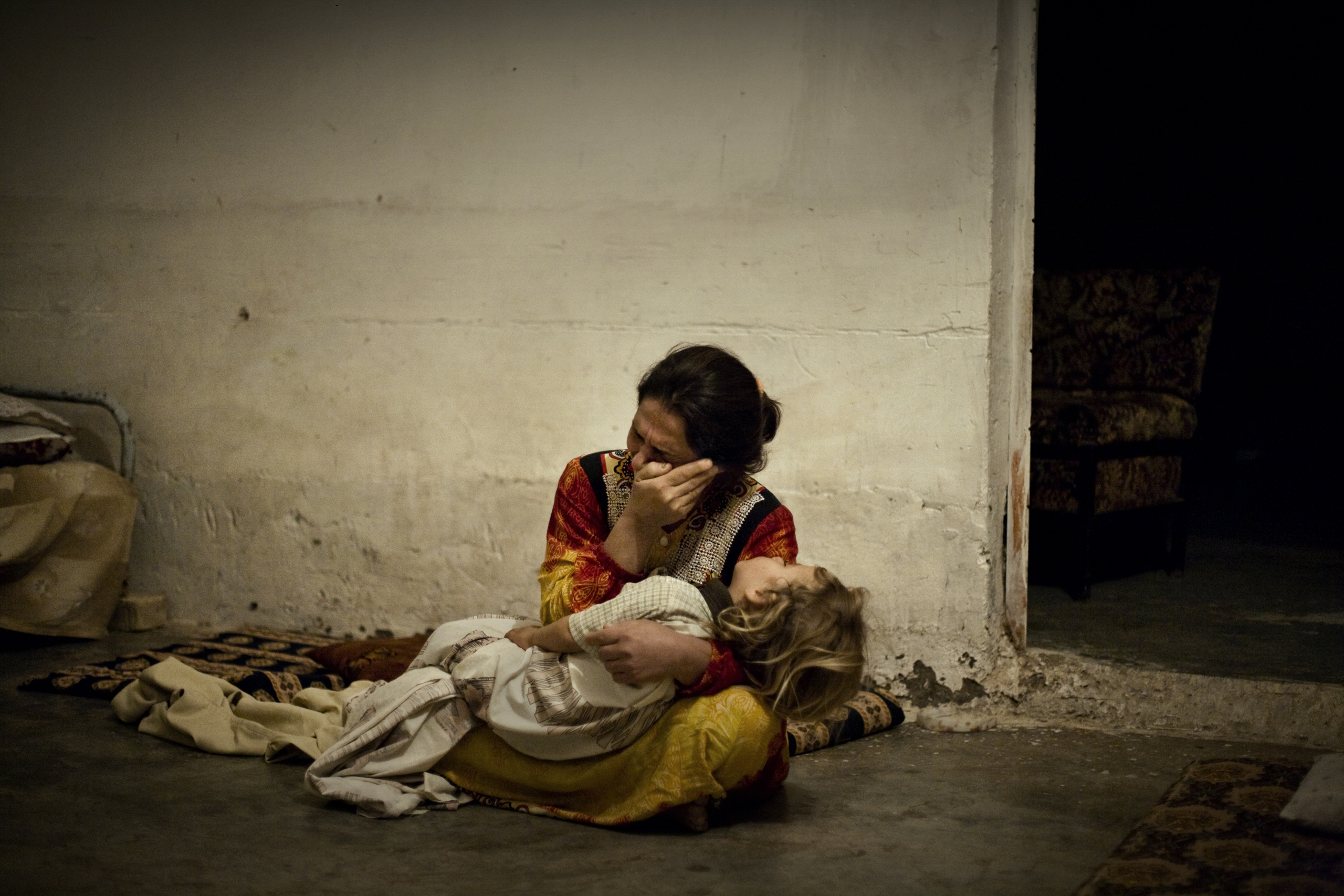 A mother cries for her seriously ill daughter at the local hospital, which was closed after insurgents attacked it, in the al Qaeda stronghold of Muqdadiyah, Diyala province, Iraq, Oct. 3, 2007.