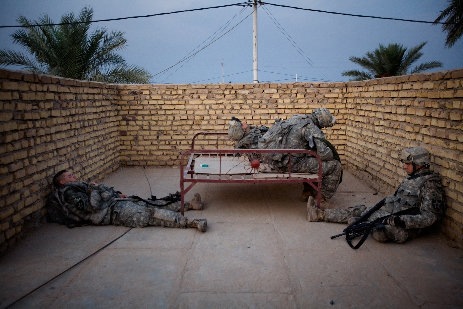 Soldiers from the 2nd Battalion Alpha Company rest between home searches on the outskirts of Muqdadiyah, Diyala province, Iraq,  Oct. 6, 2007. The area, approximately 56 miles  (90 kilometers) north of Baghdad, is a known as al Qaeda stronghold.