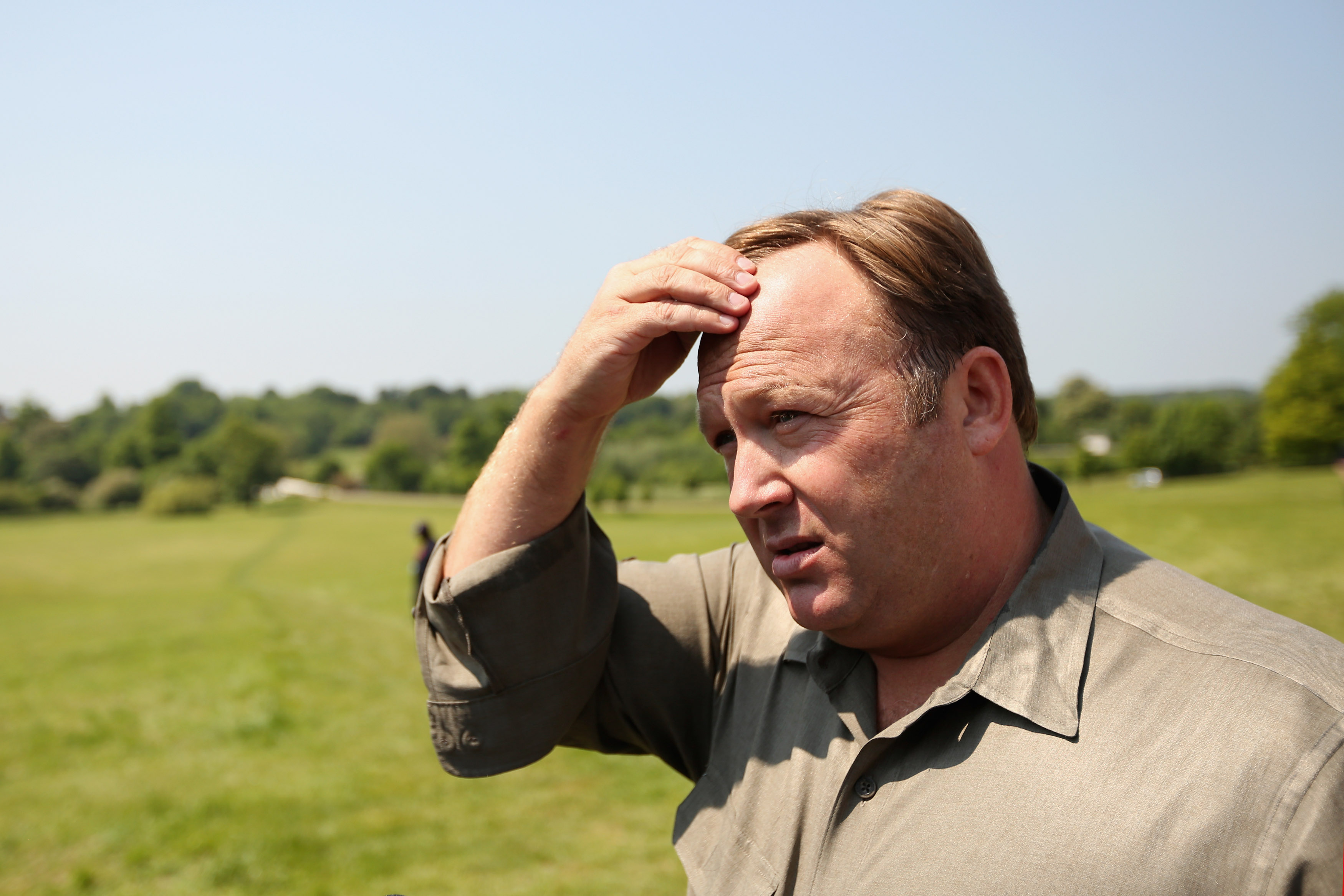 Alex Jones, an American radio host, author and conspiracy theorist, addresses media and protesters in the protester encampment outside The Grove hotel, which is hosting the annual Bilderberg conference, on June 6, 2013 in Watford, England.