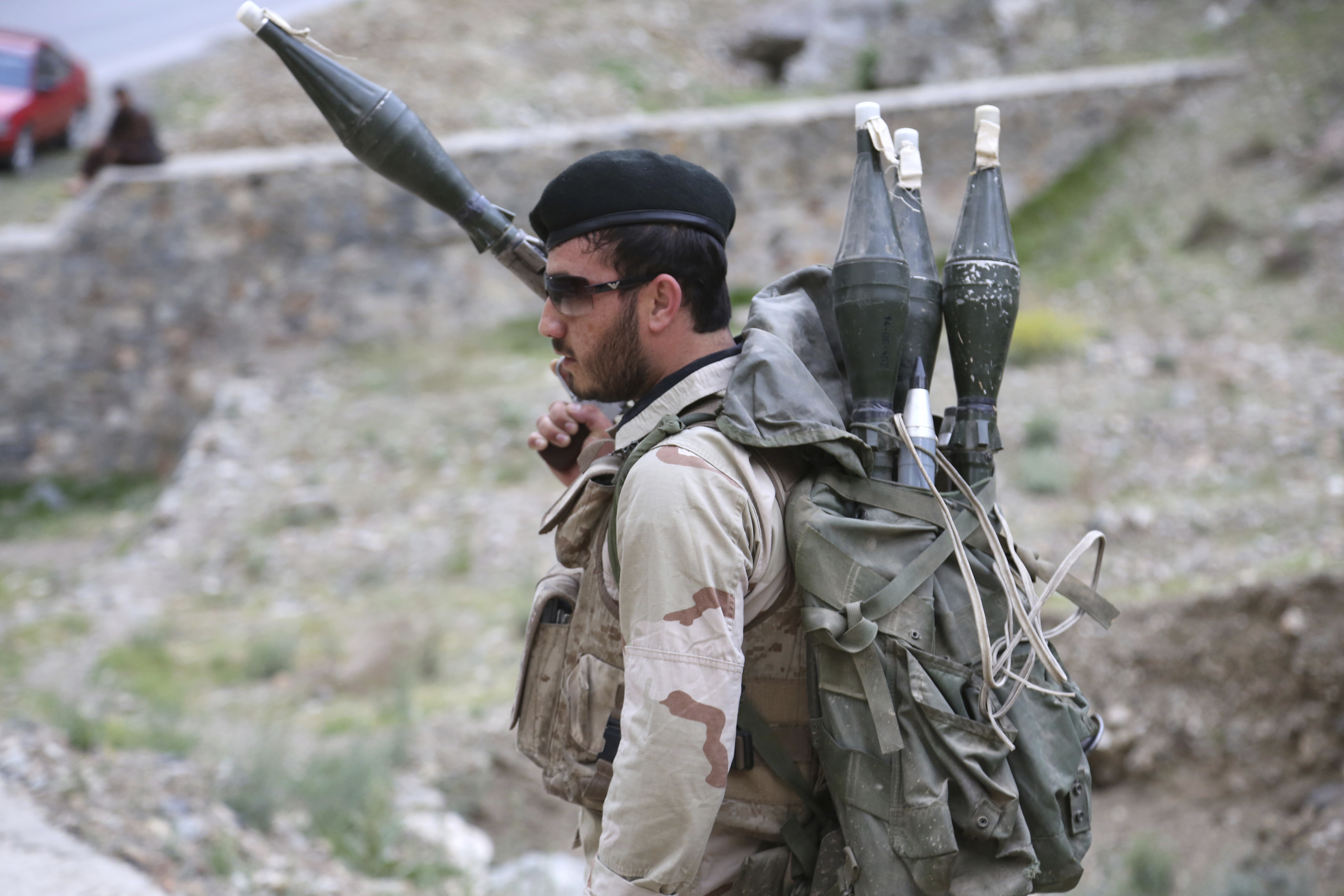 An Afghan national Army stands guard at a checkpoint on the outskirts of Kabul, Afghanistan, April 22, 2017.