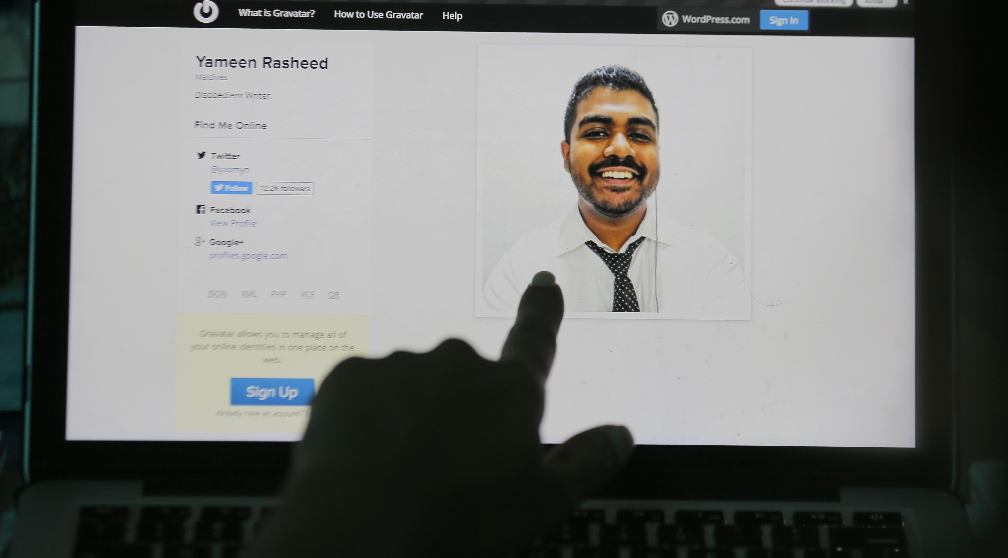 A finger pointing at a portrait of Maldivian blogger Yameen Rasheed on his blog  The Daily Panic,  April 23, 2017.