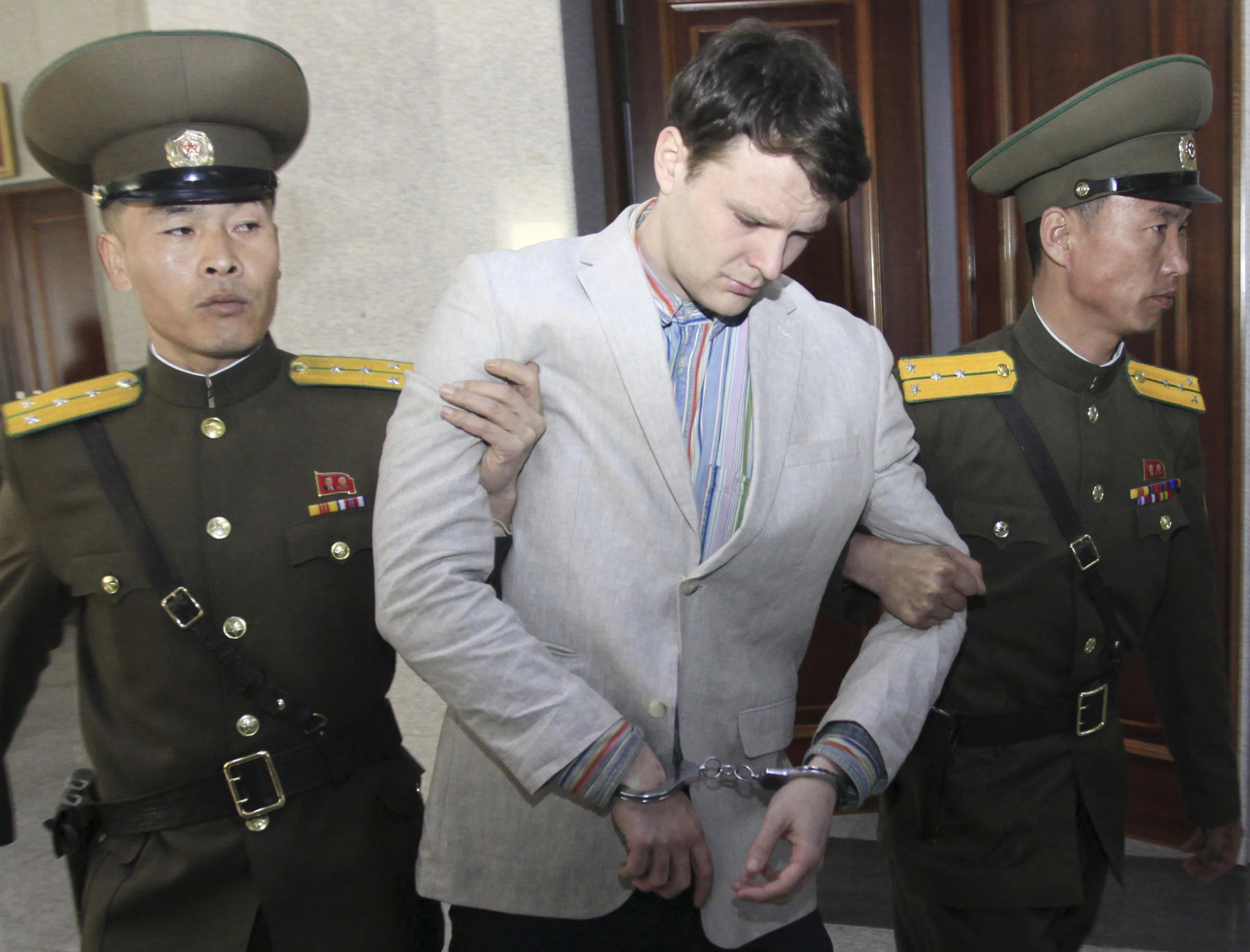 Otto Warmbier is escorted at the Supreme Court in Pyongyang on March 16, 2016. North Korea's highest court sentenced Warmbier, a 21-year-old University of Virginia undergraduate student, to 15 years in prison with hard labor for subversion.