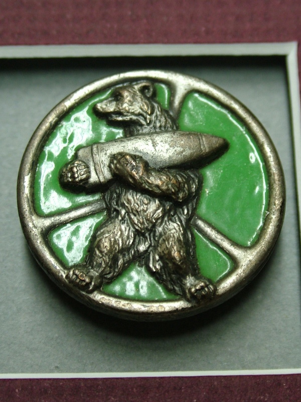 The insignia of the 22nd Artillery Support Company of the 2nd Polish Corps, meant to illustrate Wojtek the bear carrying an ammo shell at the Battle of Monte Cassino.