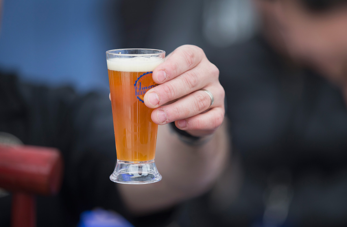 Beer lovers sample offerings from brewers at the American Beer Classic craft beer festival at Soldier Field on May 9, 2015 in Chicago.
