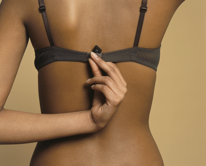 Woman Holding Bra Fastener