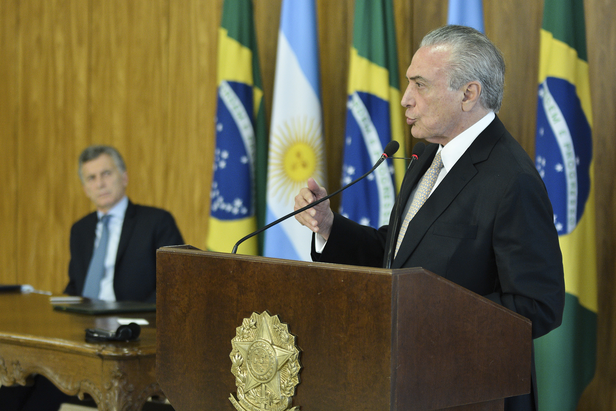 Michel Temer President of Brazil speaks during a press conference prior to signing Cooperation Agreements between Argentina and Brazil as part of an official visit to Planalto Palace on February 07, 2017 in Brasilia, Brazil.