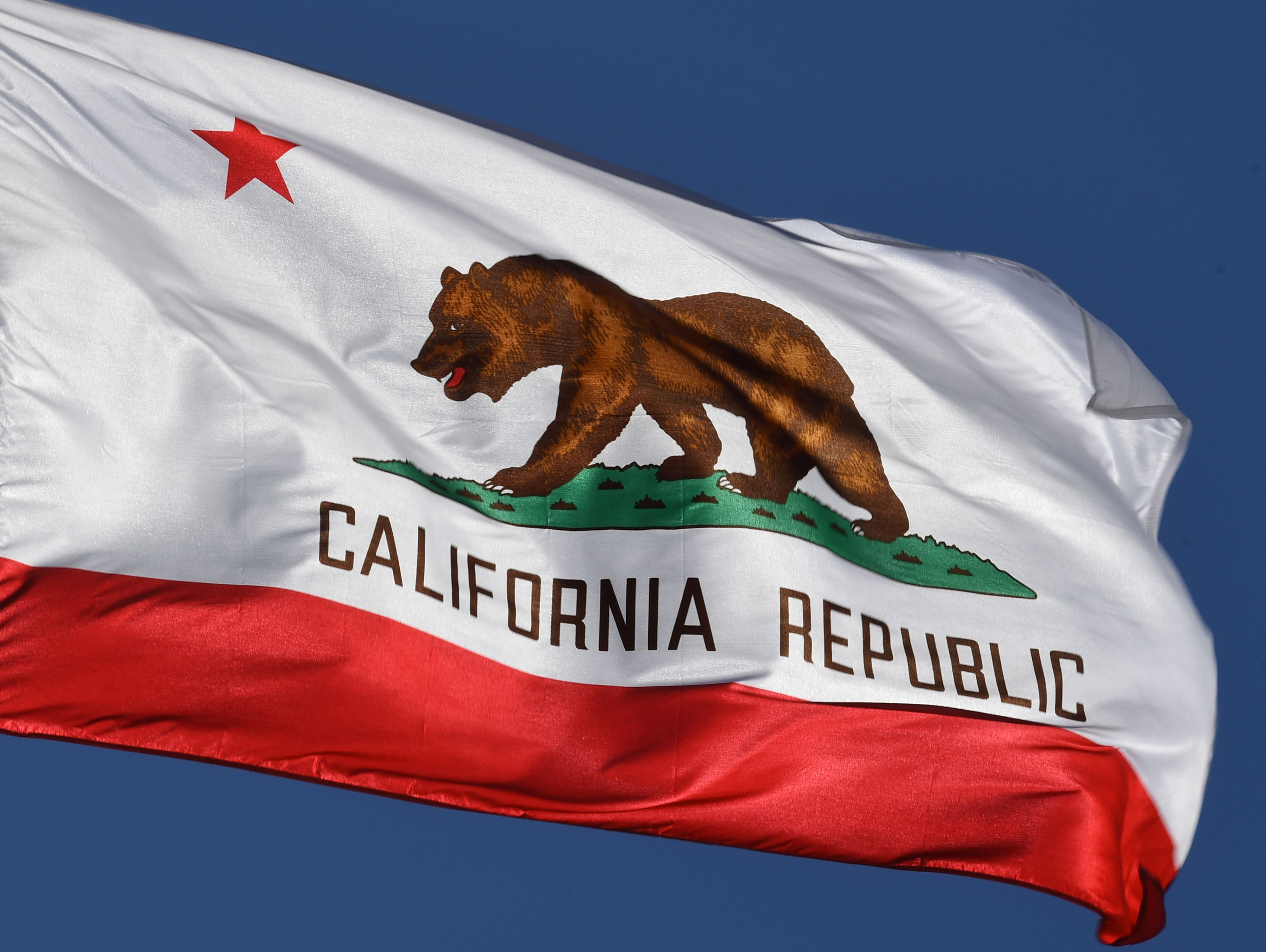 The California State flag flies outside City Hall, in Los Angeles, CA on Jan. 27, 2017.