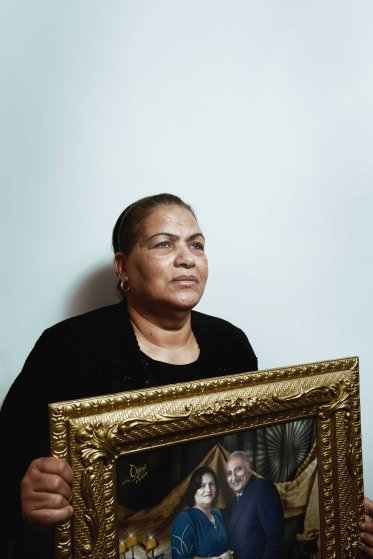 """Enayat Shenouda, 62, holds a photo of her slain husband, Saad Zaki Badawi, 73. """"Four months ago, after the recent Cairo Cathedral bombing, Saad told me he has wished he was one of the martyrs,"""" Enayat said. """"His wish came true yesterday. Now he is a martyr."""""""