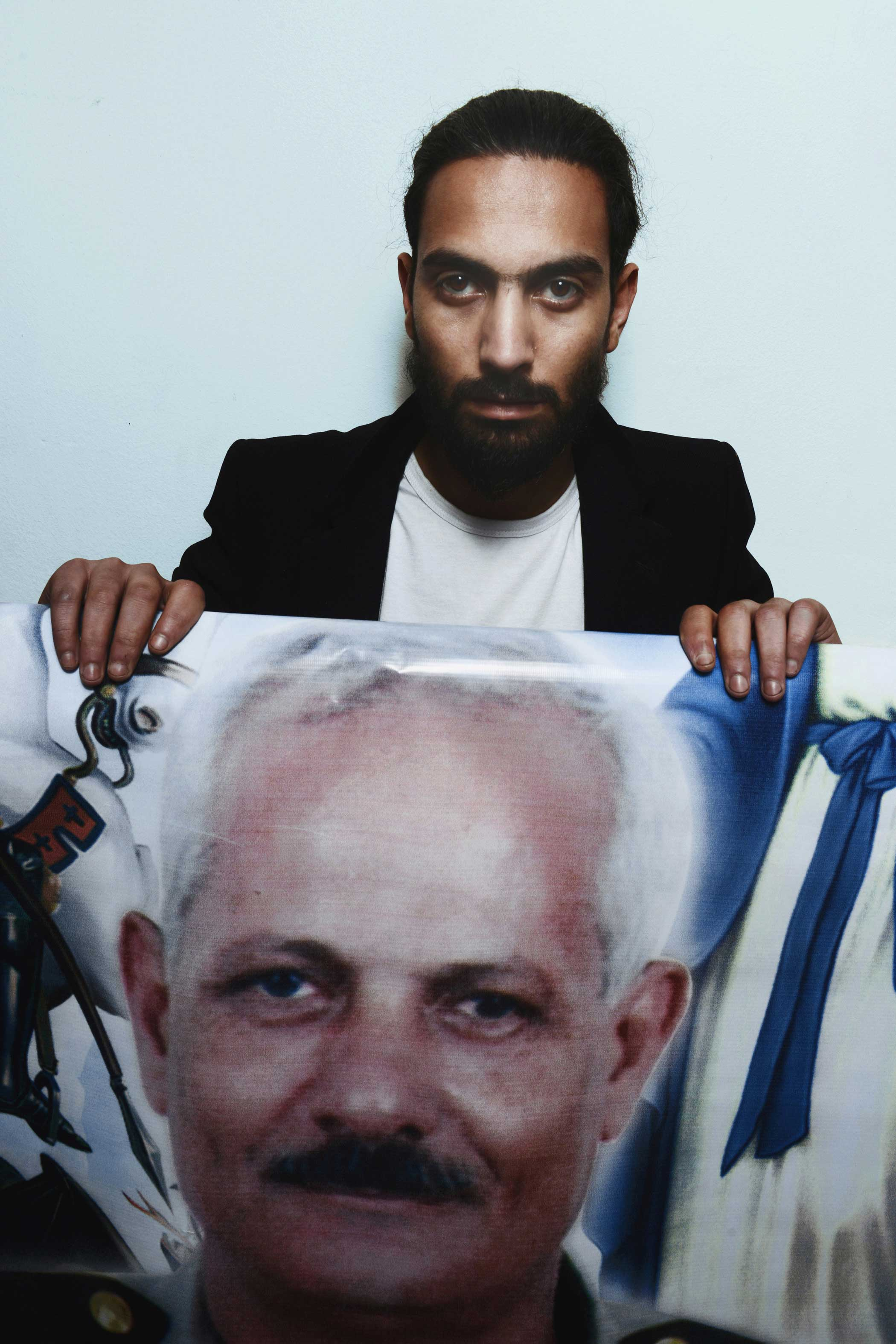 Emad Tadros, 27, holds a photo of his slain father, Medhat Tadros, 63.  My father was a military officer and a man of God. He was known for being the man of duty,  Emad said.  I was so sad when I first head the news, then I was relieved knowing he died in the church. He is a martyr,  he added.  He always sat on the front bench in all services at the church. Next year on Palm Sunday, I will sit on the same bench hoping I would die like him.