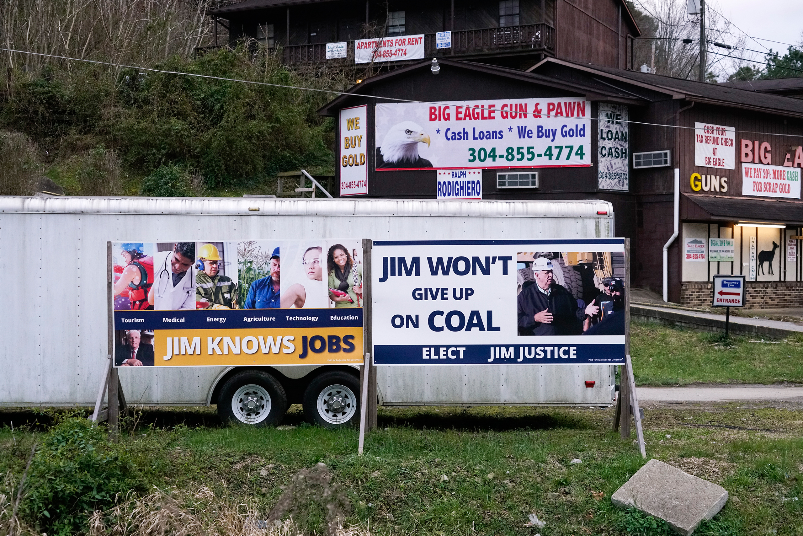 Election posters for Jim Justice (now Governor of West Virginia) appear in Chapmanville, W.Va., on Mar. 18, 2017.