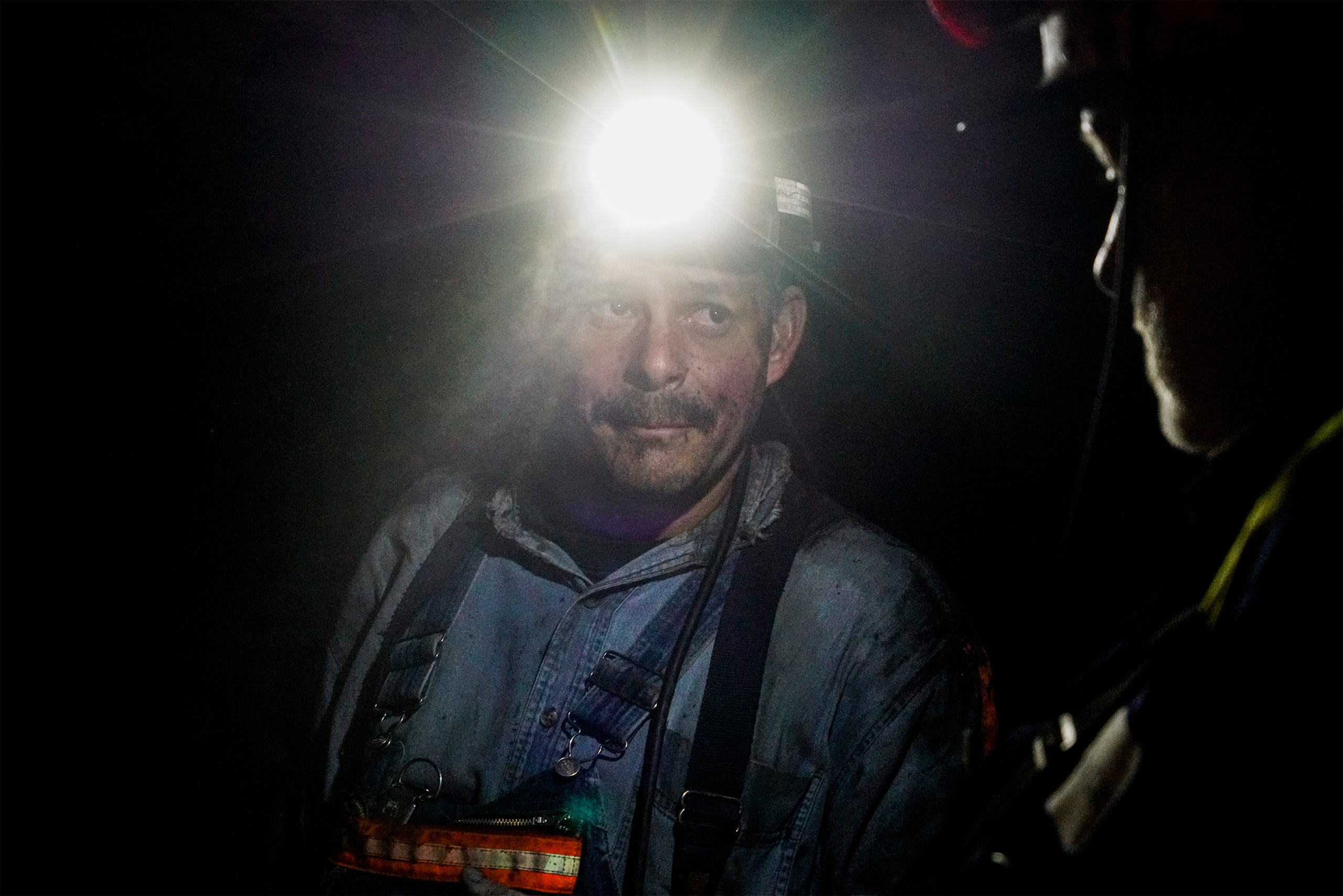 Coal miners appear in Southern Coal Corporation coal mine Pay Car Inc. No. 58 in Monroe County, W.Va., on Mar. 17, 2017.