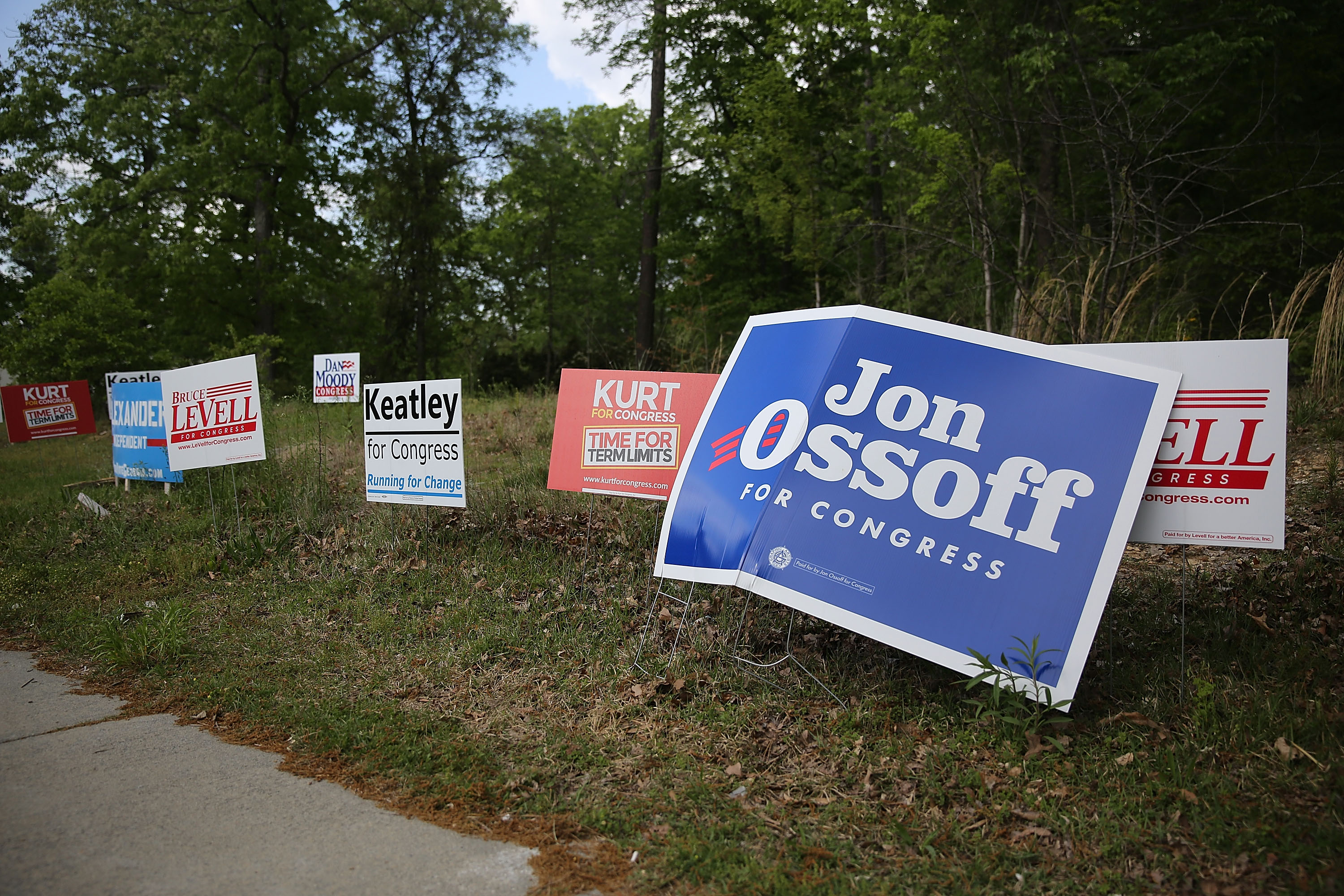 A campaign sign for Democratic candidate Jon Ossoff is seen among other candidates' signs as he runs for Georgia's 6th Congressional District in a special election to replace Tom Price, who is now the secretary of Health and Human Services on April 16, 2017 in Atlanta, Georgia.