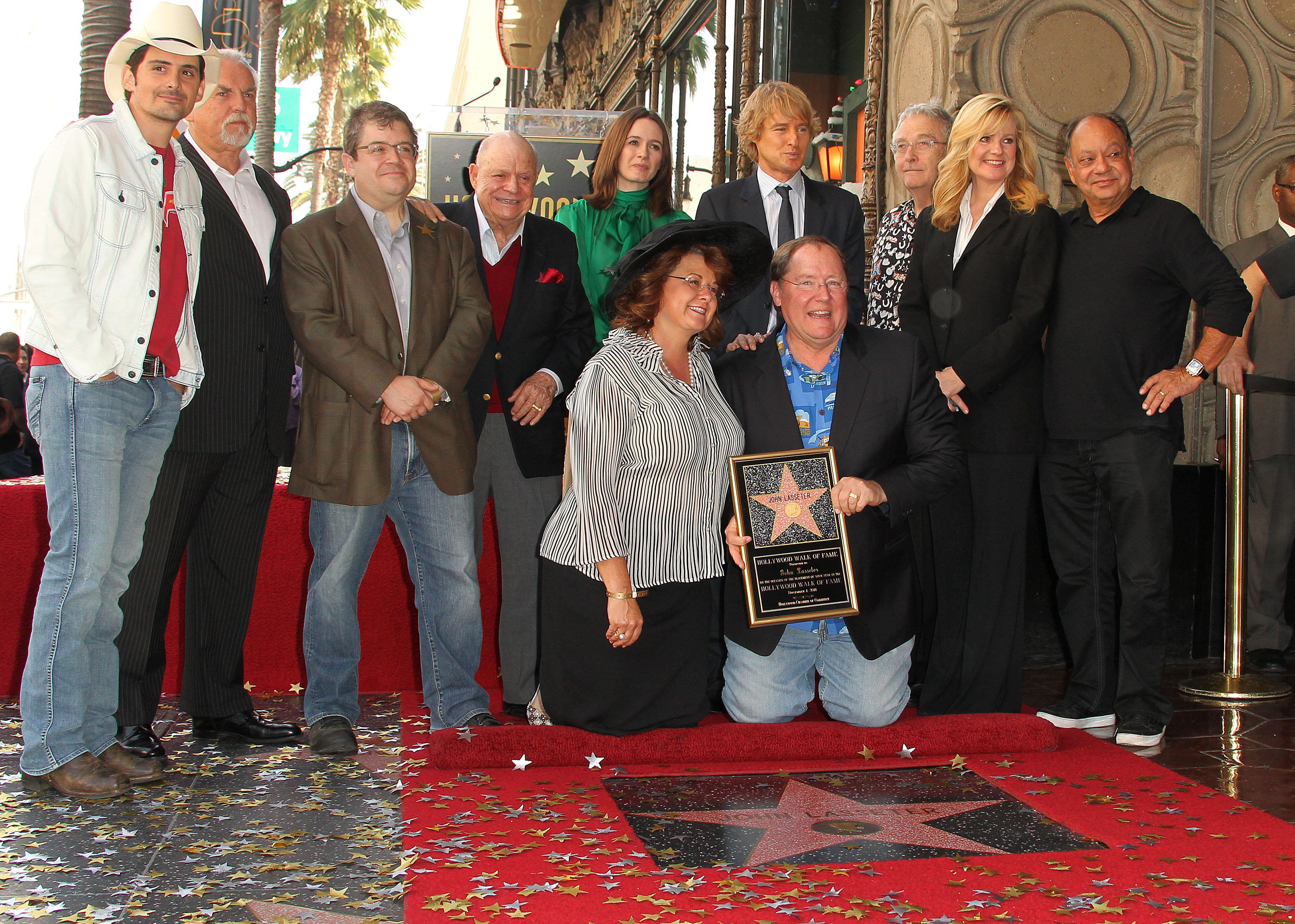 The author (third from left) and Rickles stand next to one another during the installation ceremony for director John Lasseter's star on the Hollywood Walk of Fame on Nov. 1, 2011 in Hollywood, California.