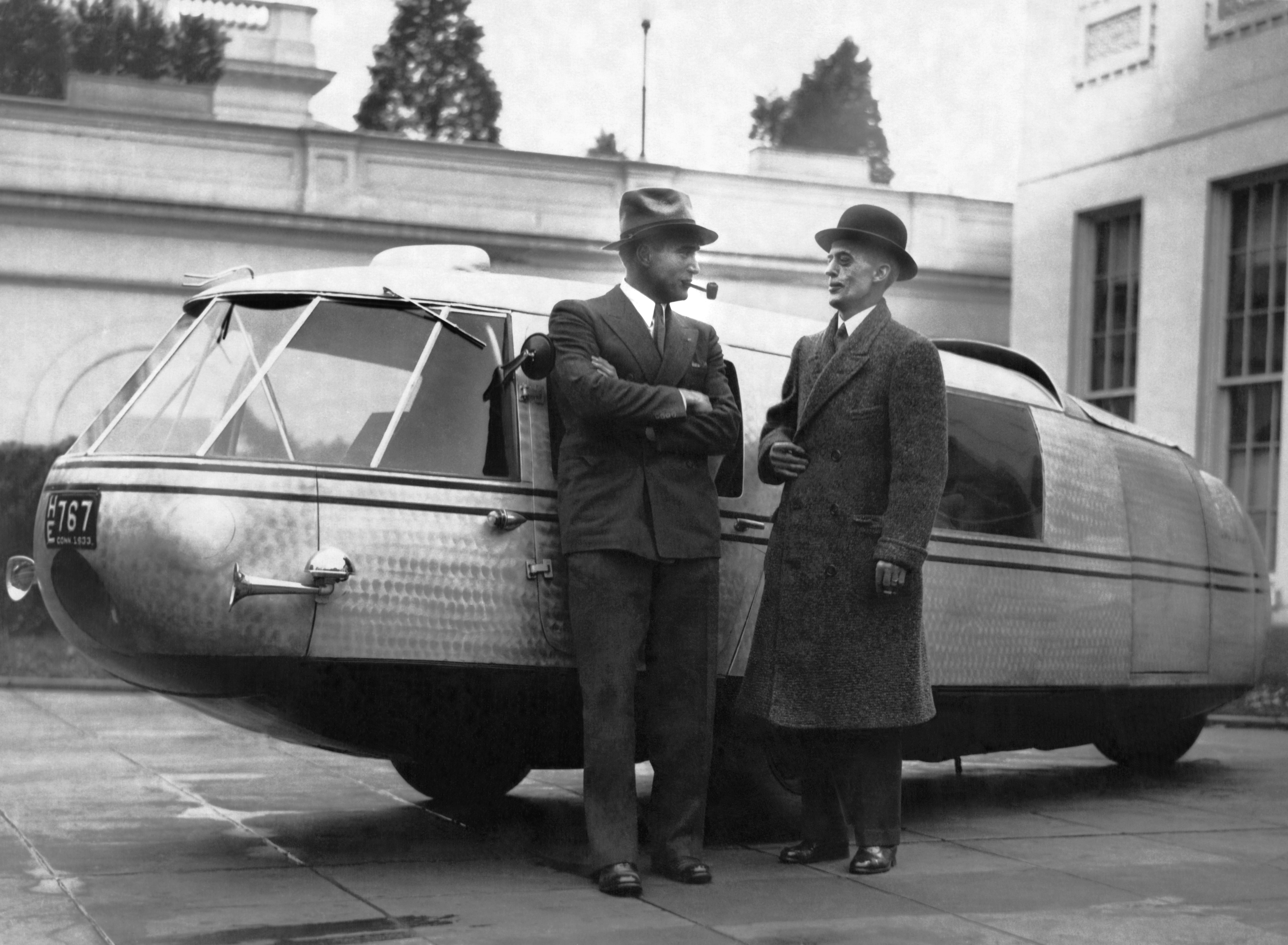 Captain Al Williams, noted speed flyer and driver, and Marvin McIntyre, Secretary to President Roosevelt, standing by the Dymaxion concept car designed by Buckminster Fuller, Washington DC, November 13, 1933. (Photo by Underwood Archives/Getty Images)