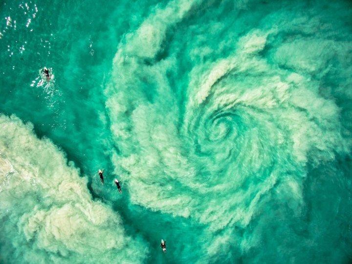 Surfers avoiding the hurricane rip in Western Australia.
