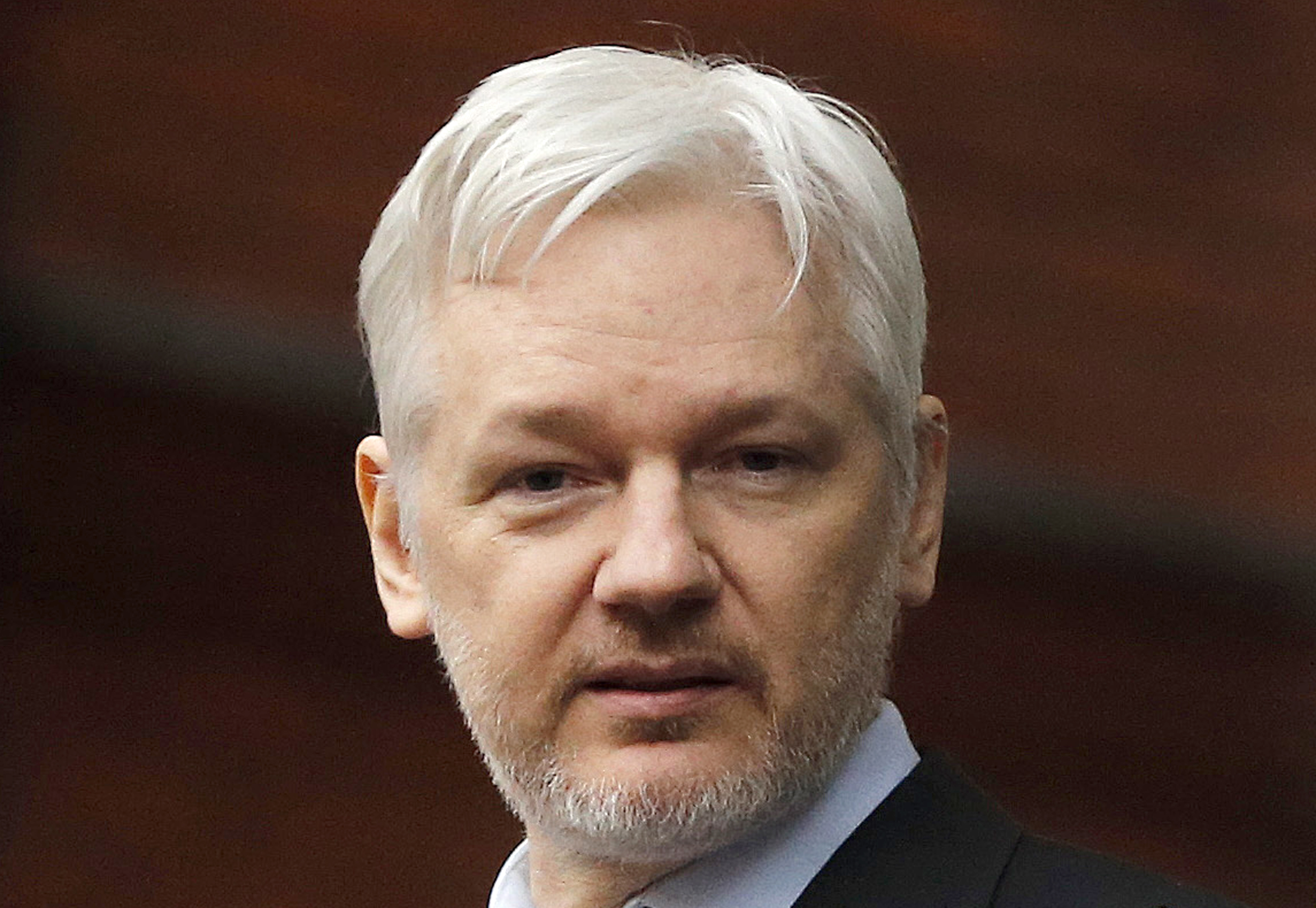 In this Feb. 5, 2016, file photo, Julian Assange stands on the balcony of the Ecuadorean Embassy in London.