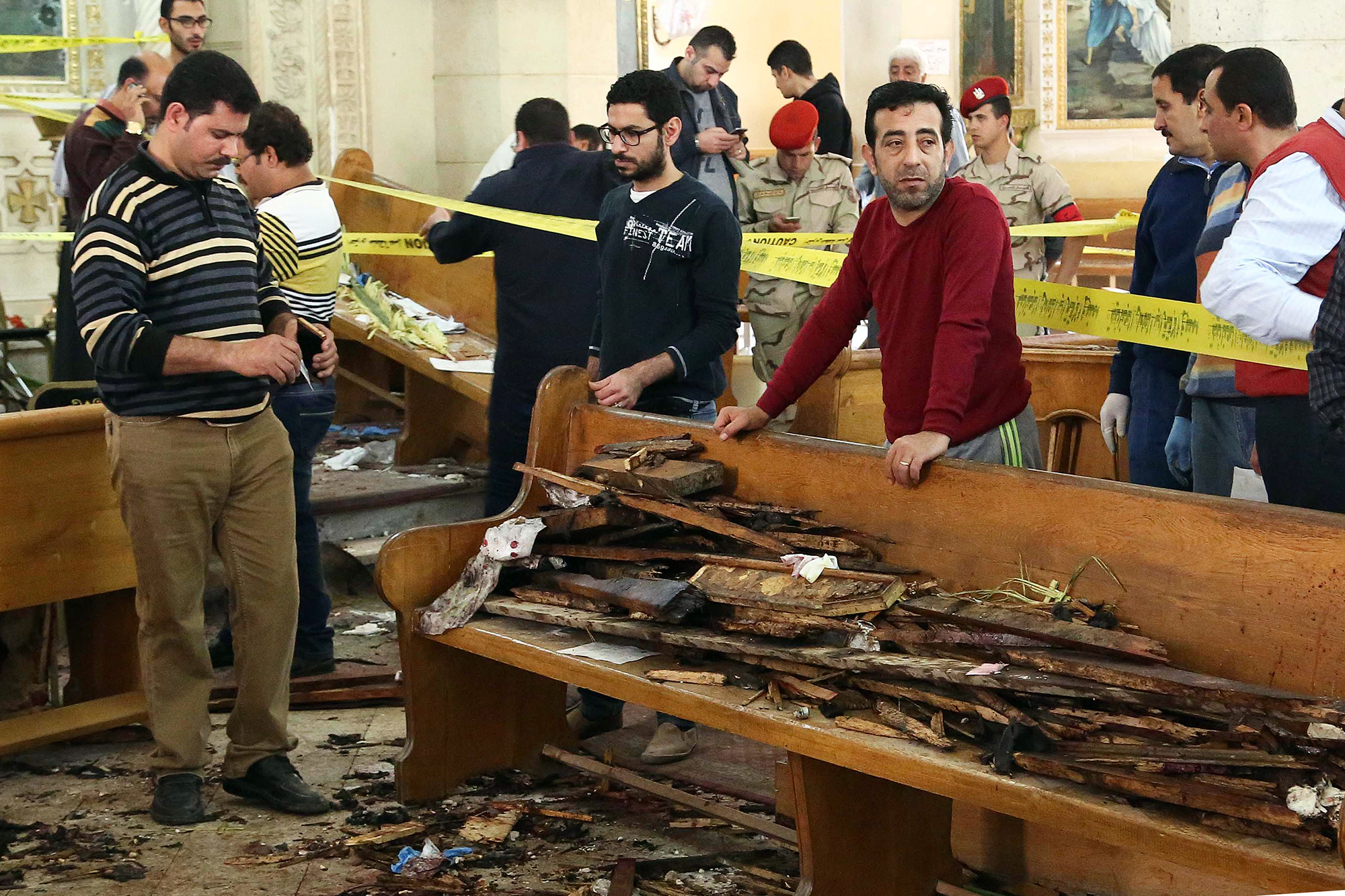 Forensics analysts collect evidence at the site of a bomb blast which struck worshippers gathering to celebrate Palm Sunday at the Mar Girgis Coptic Church in the Nile Delta City of Tanta, 75 miles north of Cairo, on April 9, 2017.