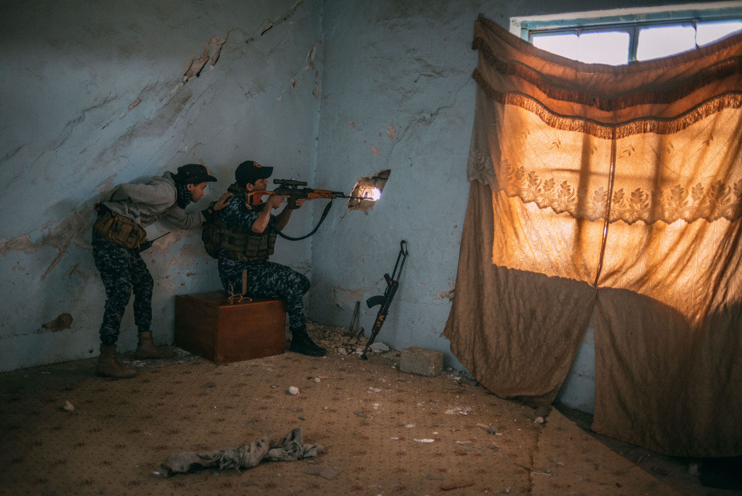 A sniper from the Iraqi Federal Police in the Dawasa neighborhood of Mosul on March 30.