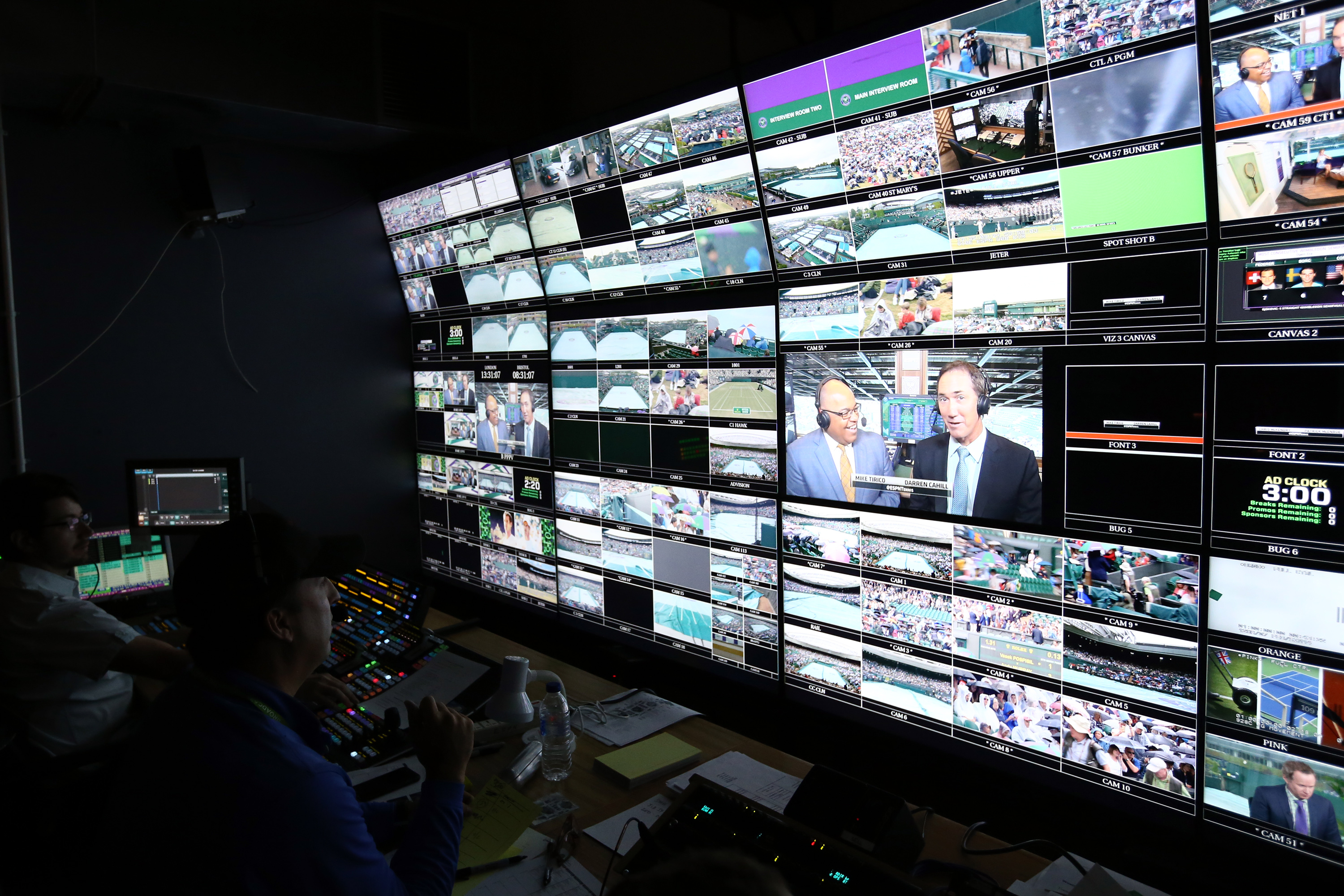 Production staff view screens in an ESPN operation room on day 9 of the Wimbledon Lawn Tennis Championships at the All England Lawn Tennis and Croquet Club on July 8, 2015 in London.